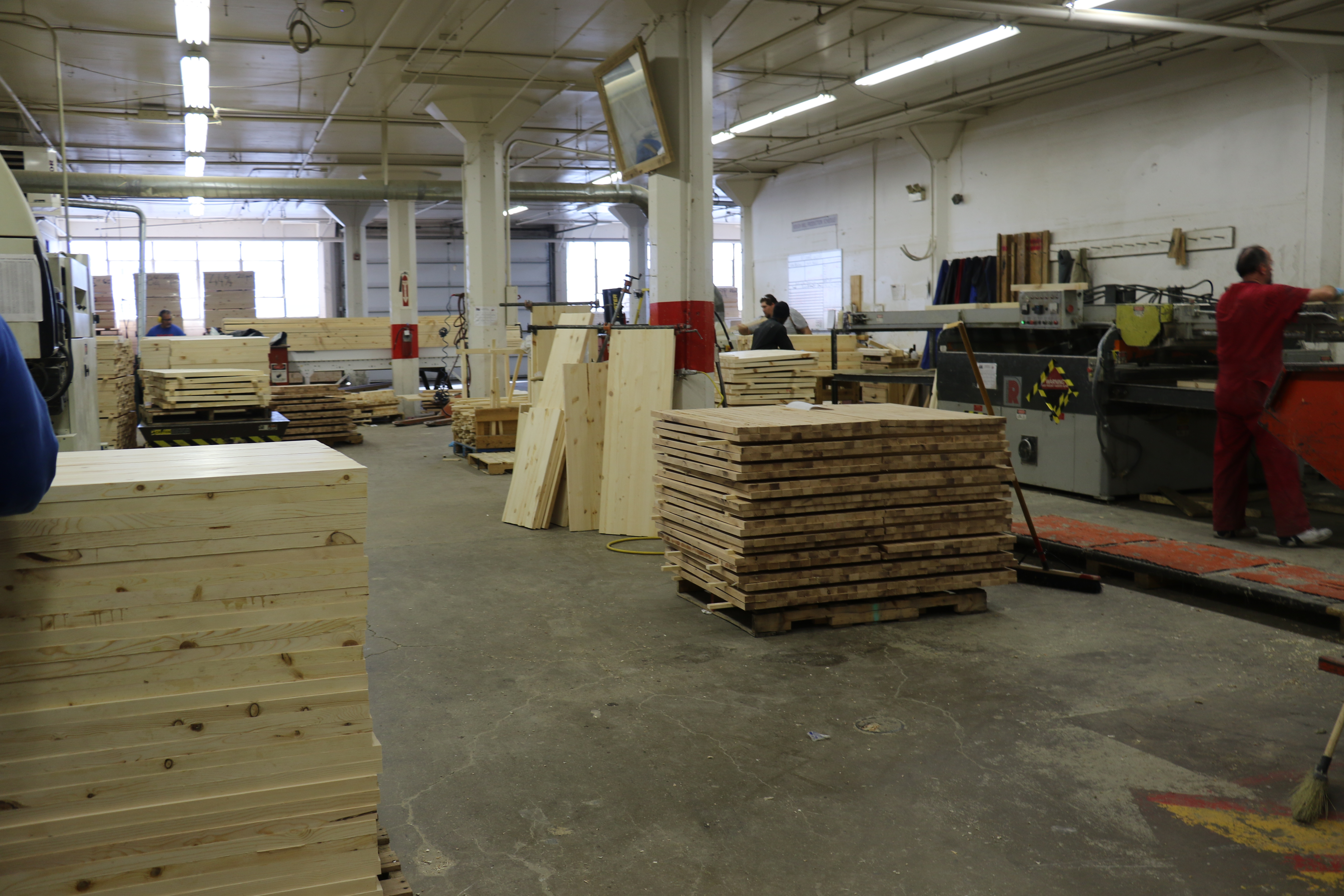 Dressers, beds and tables are made in a large wood shop in the Deseret Manufacturing plant.