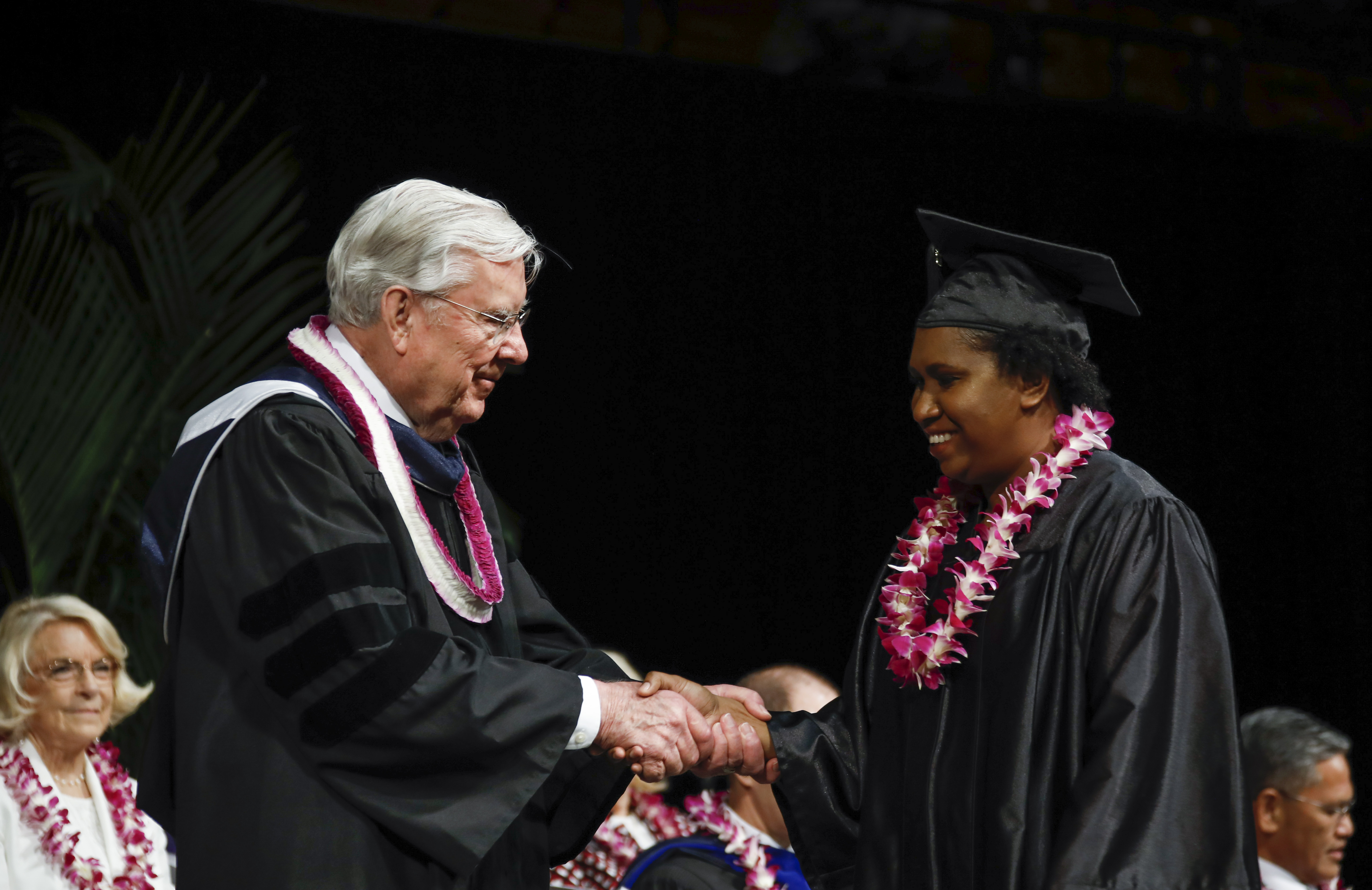 President M. Russell Ballard shakes the hand of a student during the BYU-Hawaii Winter Semester Commencement Ceremony on April 20, 2019.