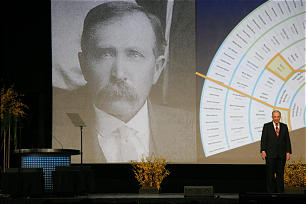 """Elder Neil L. Andersen displays his own fan chart and a photo of his great-granfather, Niels Andersen. """"Do you think I have the genes to grow a great mustache?""""he asks playfully."""