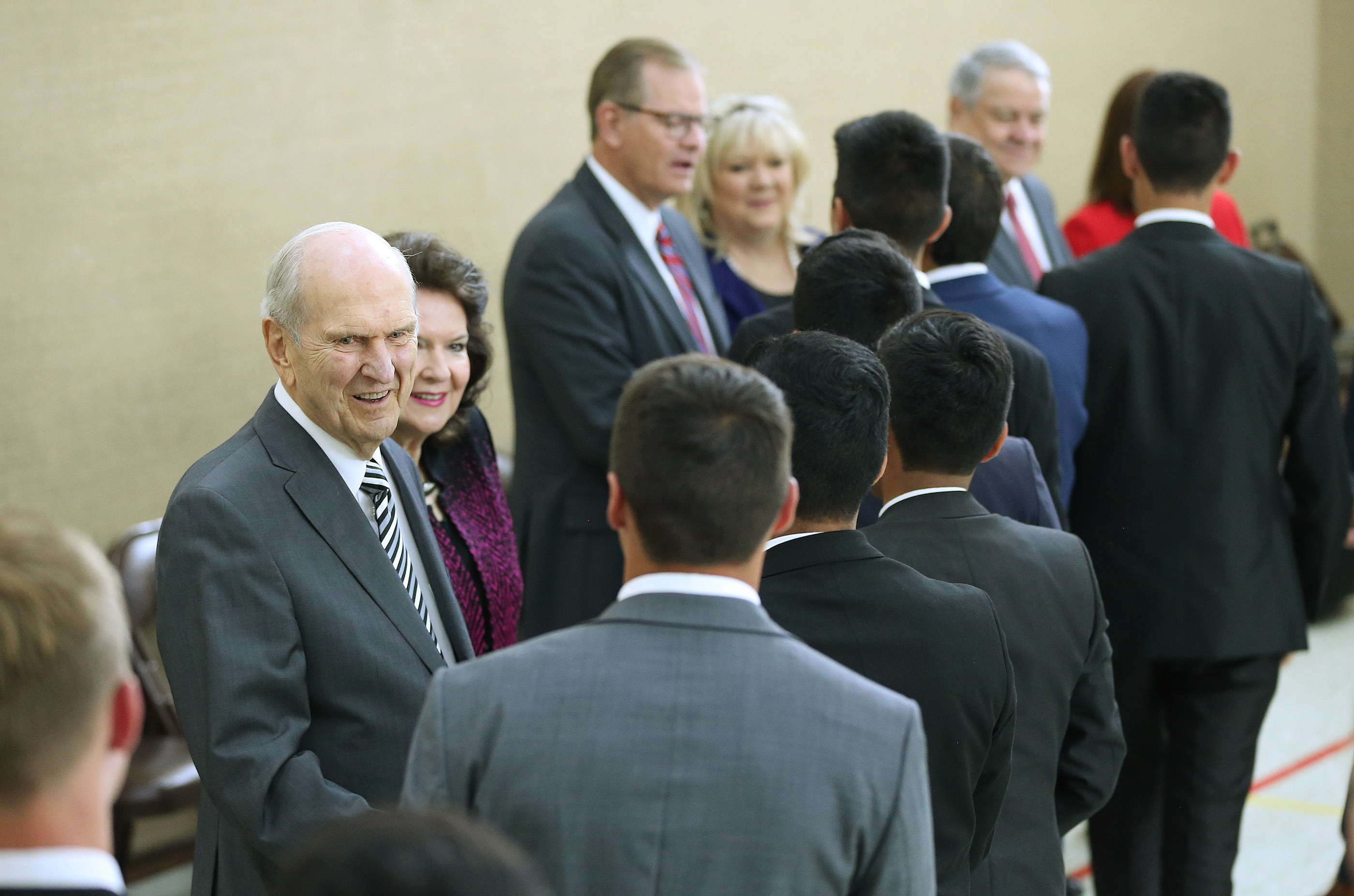 President Russell M. Nelson of The Church of Jesus Christ of Latter-day Saints, and his wife, Sister Wendy Nelson, and Elder Gary E. Stevenson of the Quorum of the Twelve Apostles and his wife, Sister Lesa Stevenson, greet missionaries prior to a missionary meeting in Montevideo, Uruguay on Thursday, Oct. 25, 2018.