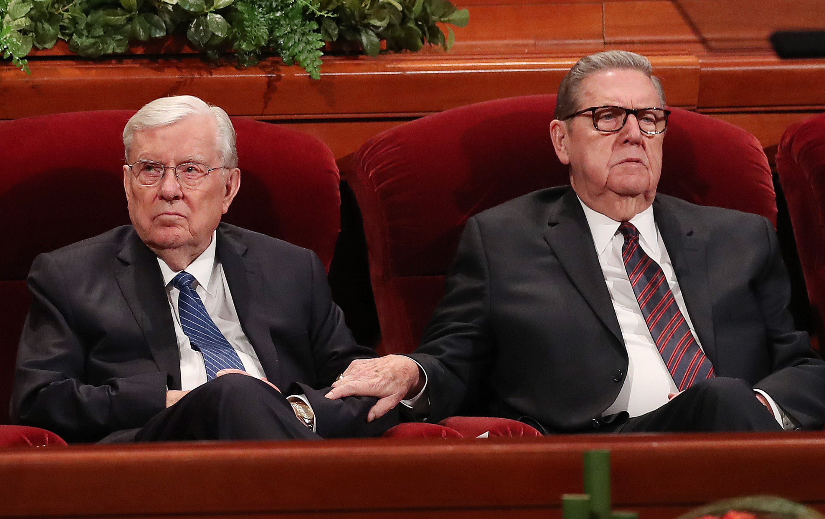 Elder Jeffrey R. Holland of The Church of Jesus Christ of Latter-day Saints' Quorum of the Twelve Apostles, right, holds the arm of Elder M. Russell Ballard of the Quorum of the Twelve Apostles during the Saturday morning session of the 188th Semiannual General Conference of The Church of Jesus Christ of Latter-day Saints in the Conference Center in Salt Lake City on Saturday, Oct. 6, 2018.