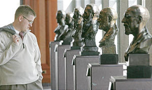 Chris Ellsworth (cq) admires the busts of the LDS prophets in the Conference Center during the Sunday afternoon session of the 176th annual general conference of the Church of Jesus Christ of Latter-day Saints in Salt Lake City, Utah April 2, 2006. Photo by Keith Johnson/Deseret Morning News 176th annual.