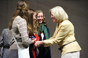 Sister Dalton greets three young women from among the many audience members who approached and conversed with her after the conclusion of her address.