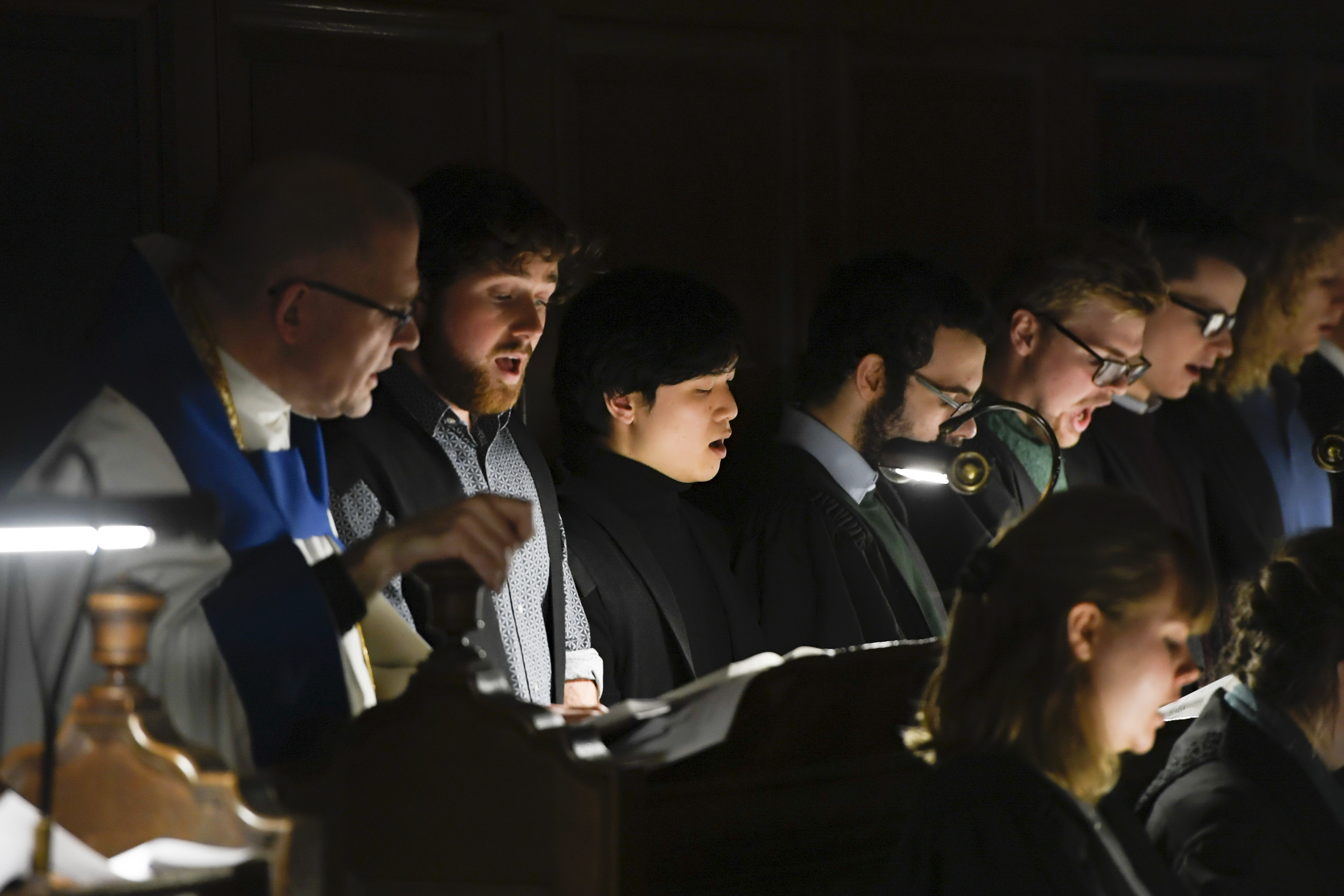 """The Pembroke College Chapel Choir and the chapel's chaplain, the Rev. Andrew Teal, left, sing during the traditional Church of England """"Nine Lessons and Carols"""" service at the Pembroke College Chapel in Oxford, England, on Sunday, Nov. 25, 2018."""
