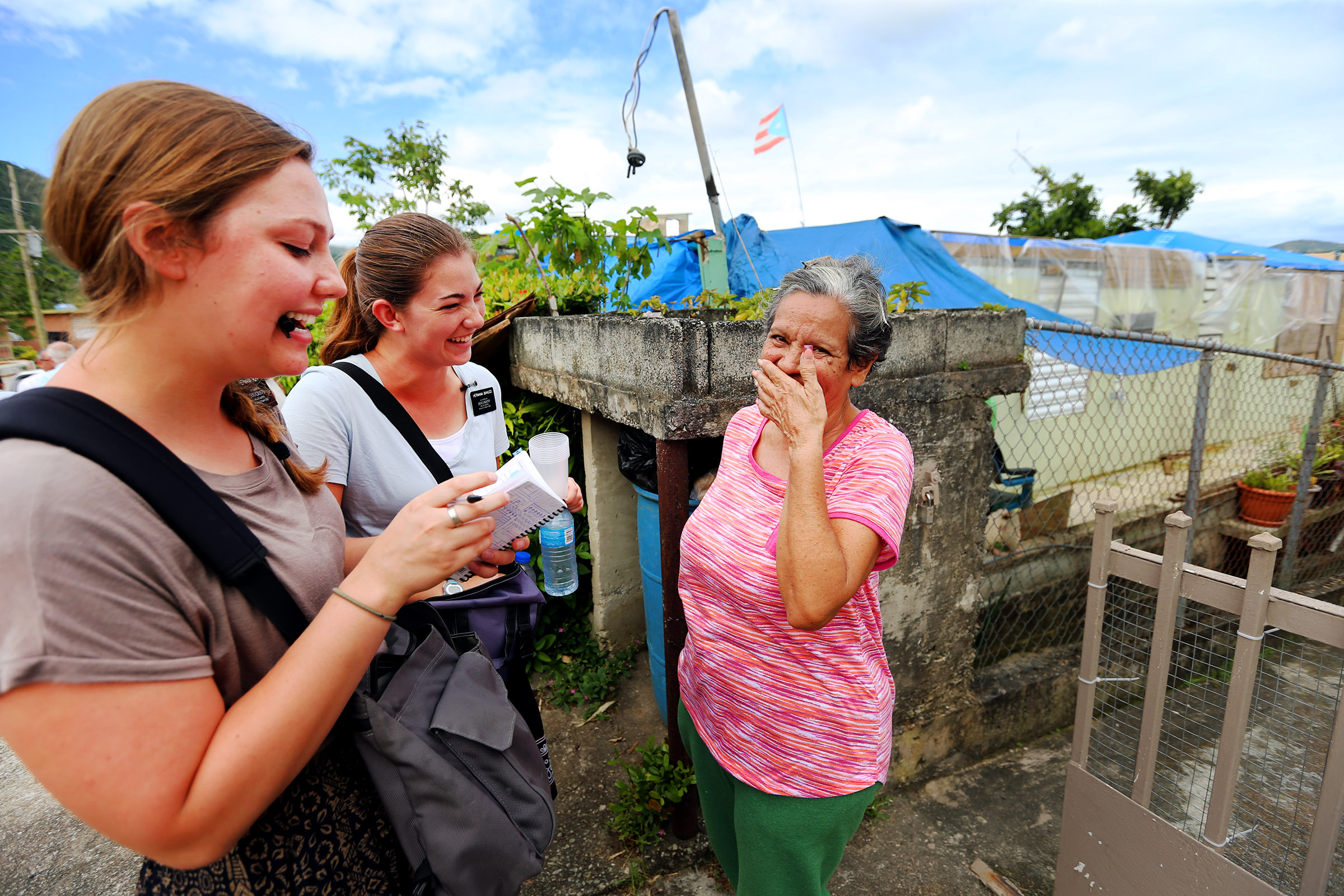 Sister's Mary Ruff from Midvale Utah, and Erin Bianucci from Layton Utah, talk with Luci Morales in Puerto Rico on Saturday, Feb. 17, 2018.