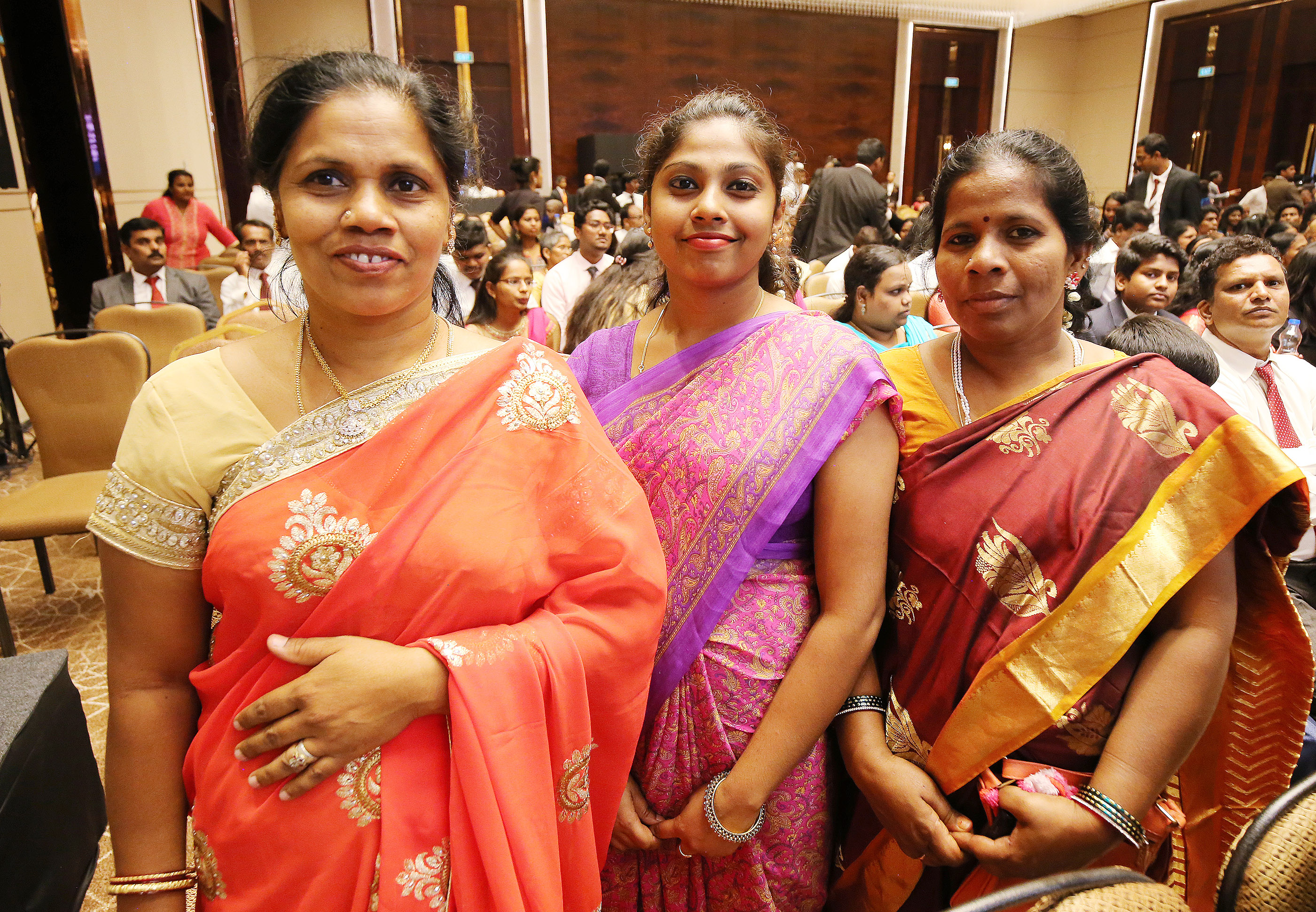 Cousins Kannagi Raui, Pavithra Rajan and Dewvi Thambi attend a devotional with President Russell M. Nelson in Bengaluru, India, on Thursday, April 19, 2018.