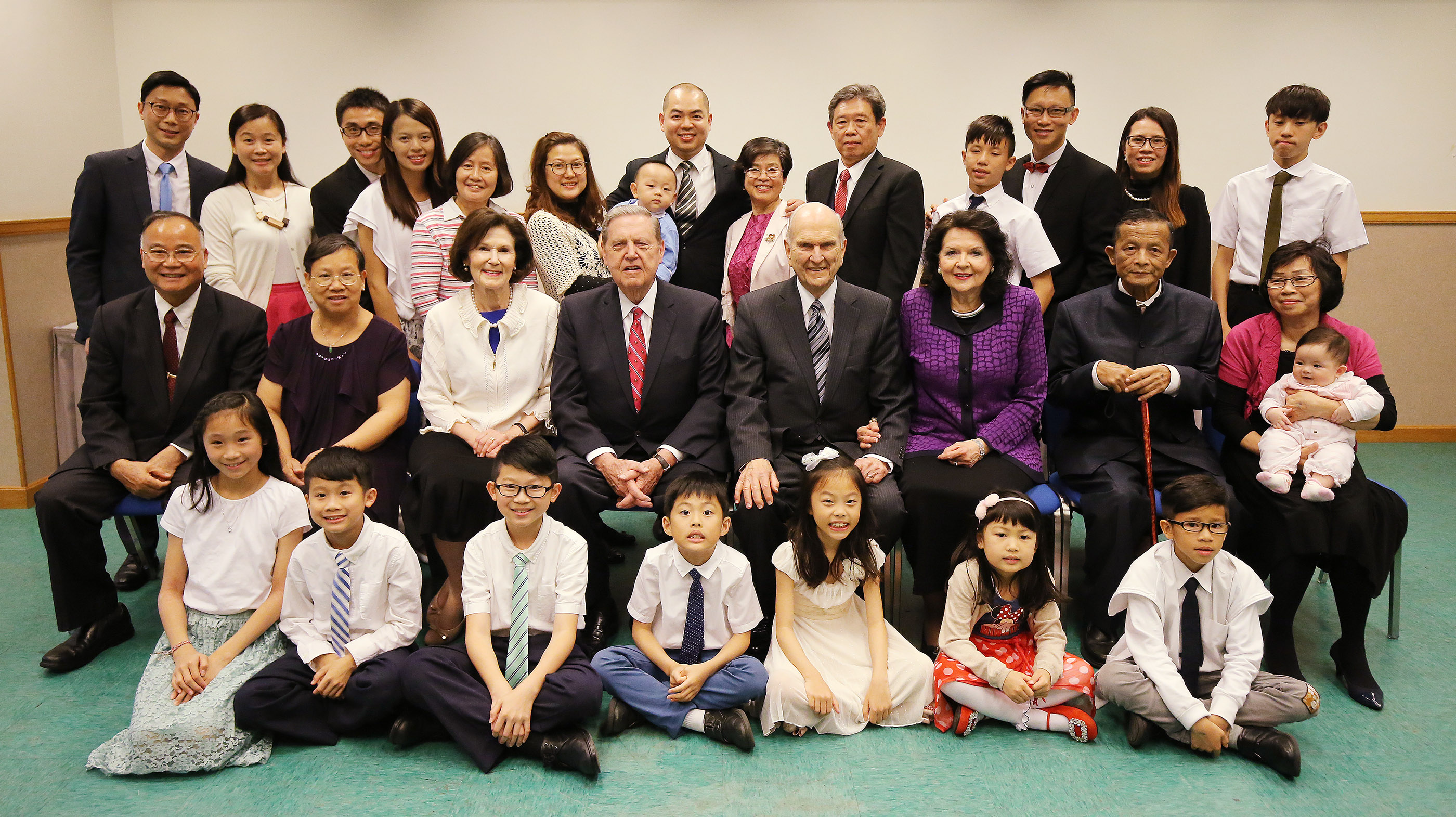 President Russell M. Nelson — along with his wife, Sister Wendy Nelson, and Elder Jeffrey R. Holland, Quorum of the Twelve Apostles, and his wife, Sister Patricia Holland — pose for a photo with local multi-generational Church members in Hong Kong on Saturday, April 21, 2018.