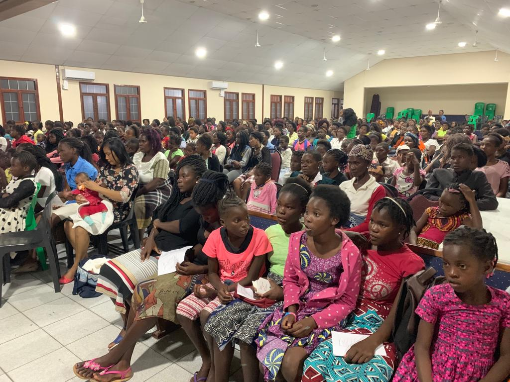 Members in Beira, Mozambique, gather for a meeting with Sister Bonnie H. Cordon in May 2019.