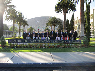 Elder Dallin H. Oaks and other General Authorities and Mexico City MTC officials and several of their respective wives pose on the grounds of the historic MTC campus in Mexico City.
