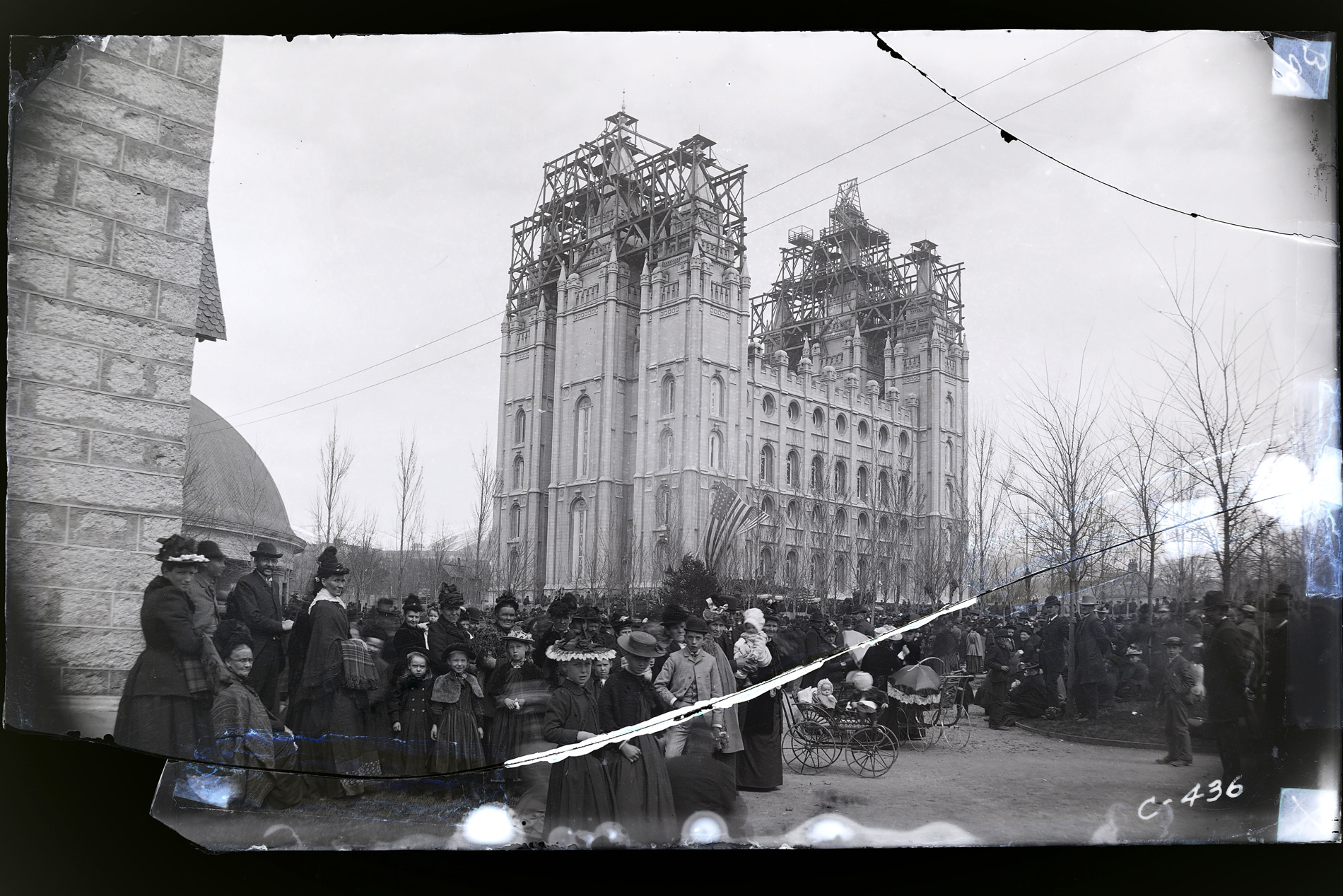 Cracked and taped glass negative of the capstone ceremony of the Salt Lake Temple, 6 April 1892, before restoration of the image.