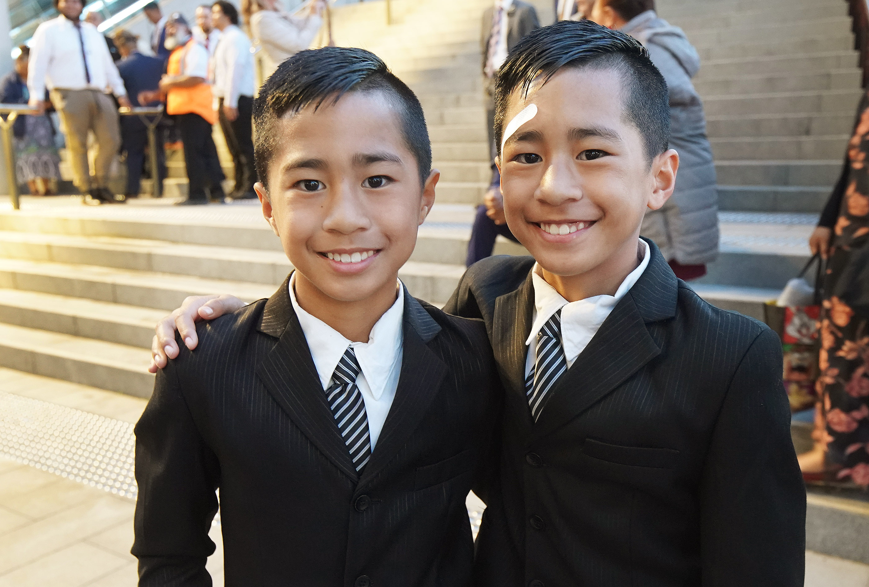 Twins Darren and Donovan Mekaio wait to hear President Russell M. Nelson of The Church of Jesus Christ of Latter-day Saints on May 19, 2019, in Sydney, Australia.