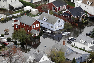 Houses are surrounded by floodwaters in the wake of superstorm Sandy on Tuesday, Oct. 30, 2012, in Little Ferry, N.J. Sandy, the storm that made landfall Monday, caused multiple fatalities, halted mass transit and cut power to more than 6 million homes and businesses.
