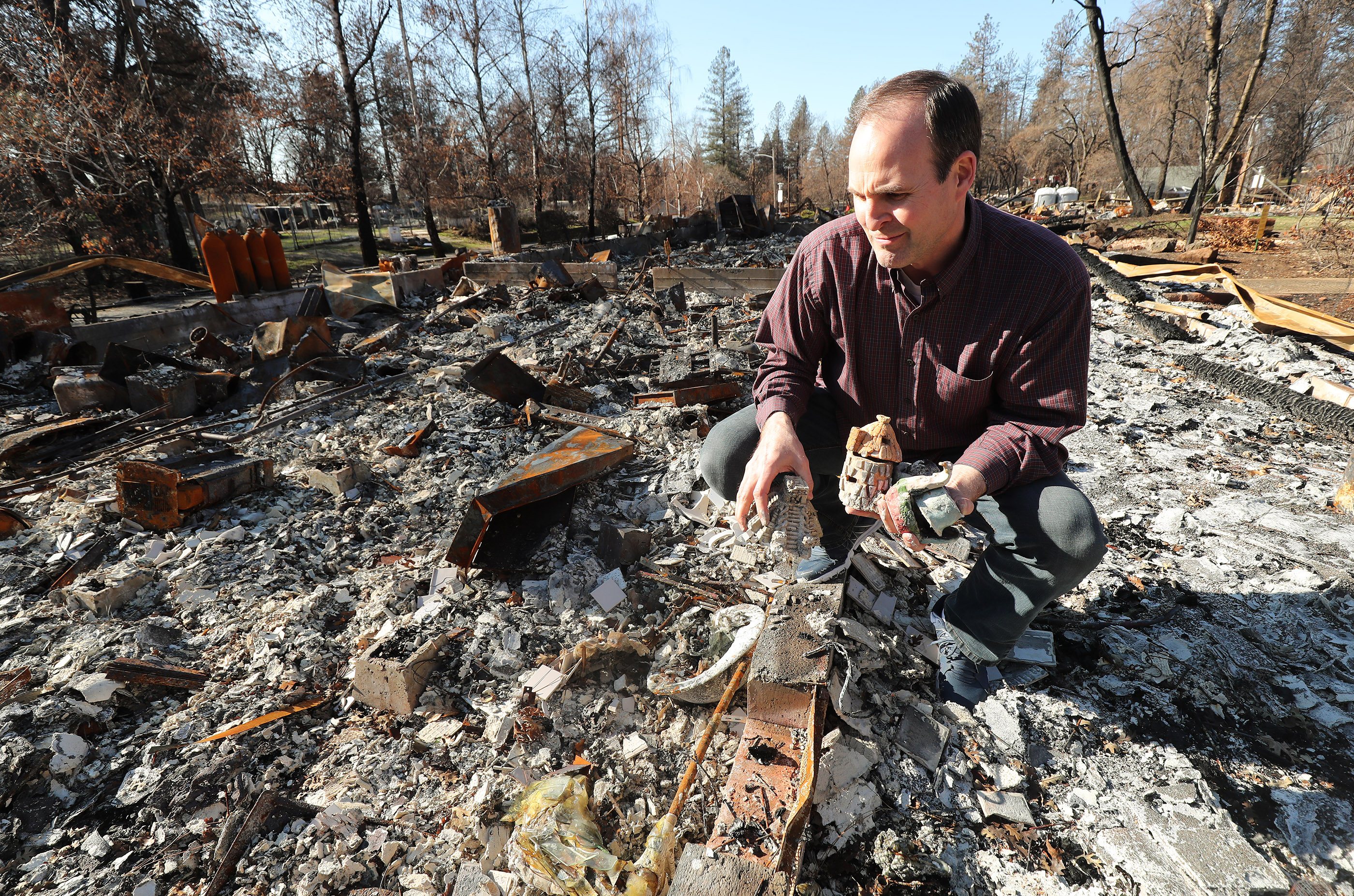 Jeremy Chatfield finds items from his destroyed dental office in Paradise, California, on Saturday, Jan. 12, 2019, two months after the Camp Fire destroyed more than 18,000 homes and businesses.. Chatfield also lost his home.