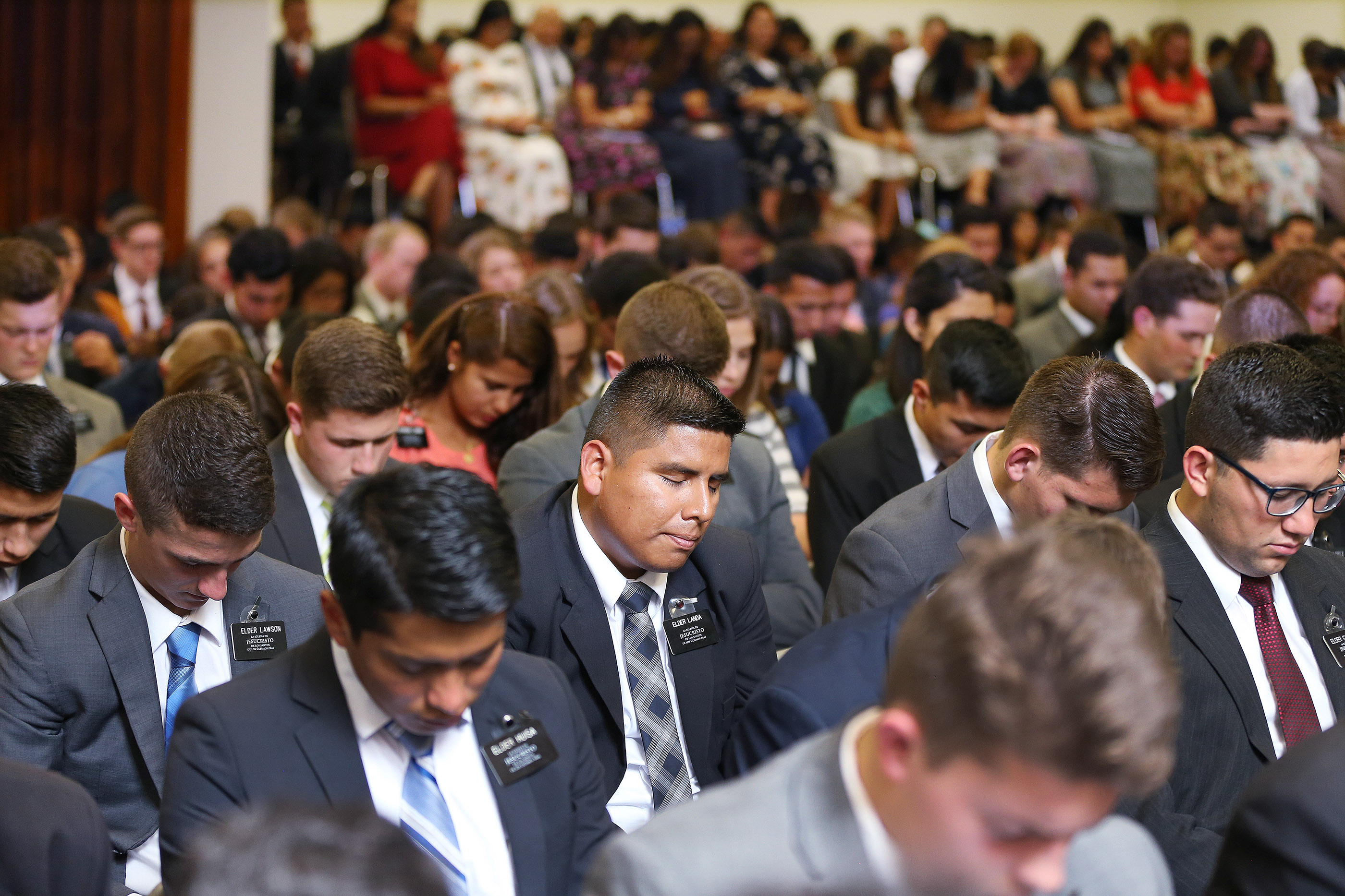 Missionaries listen to the prayer during their meeting with President Russell M. Nelson of The Church of Jesus Christ of Latter-day Saints and Elder Gary E. Stevenson of the Quorum of the Twelve Apostles in Lima, Peru, on Oct. 20, 2018.