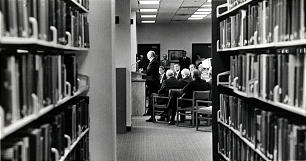 Framed by genealogical volumes in stacks on main level, President Gordon B. Hinckley addresses 185 guests who gathered for dedication of new Genealogical (Family History) Library on Oct. 23, 1985.