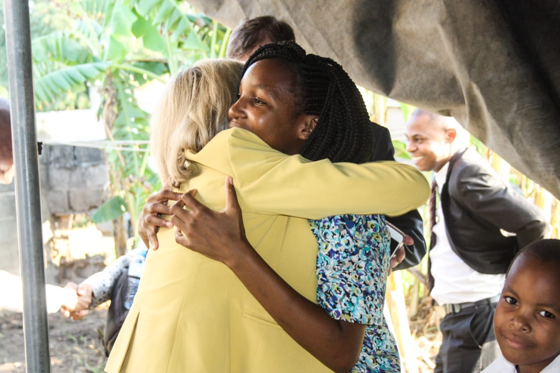 Sister Bonnie H. Cordon hugs a member in Maputo, Mozambique, during a ministering home visit in May 2019.