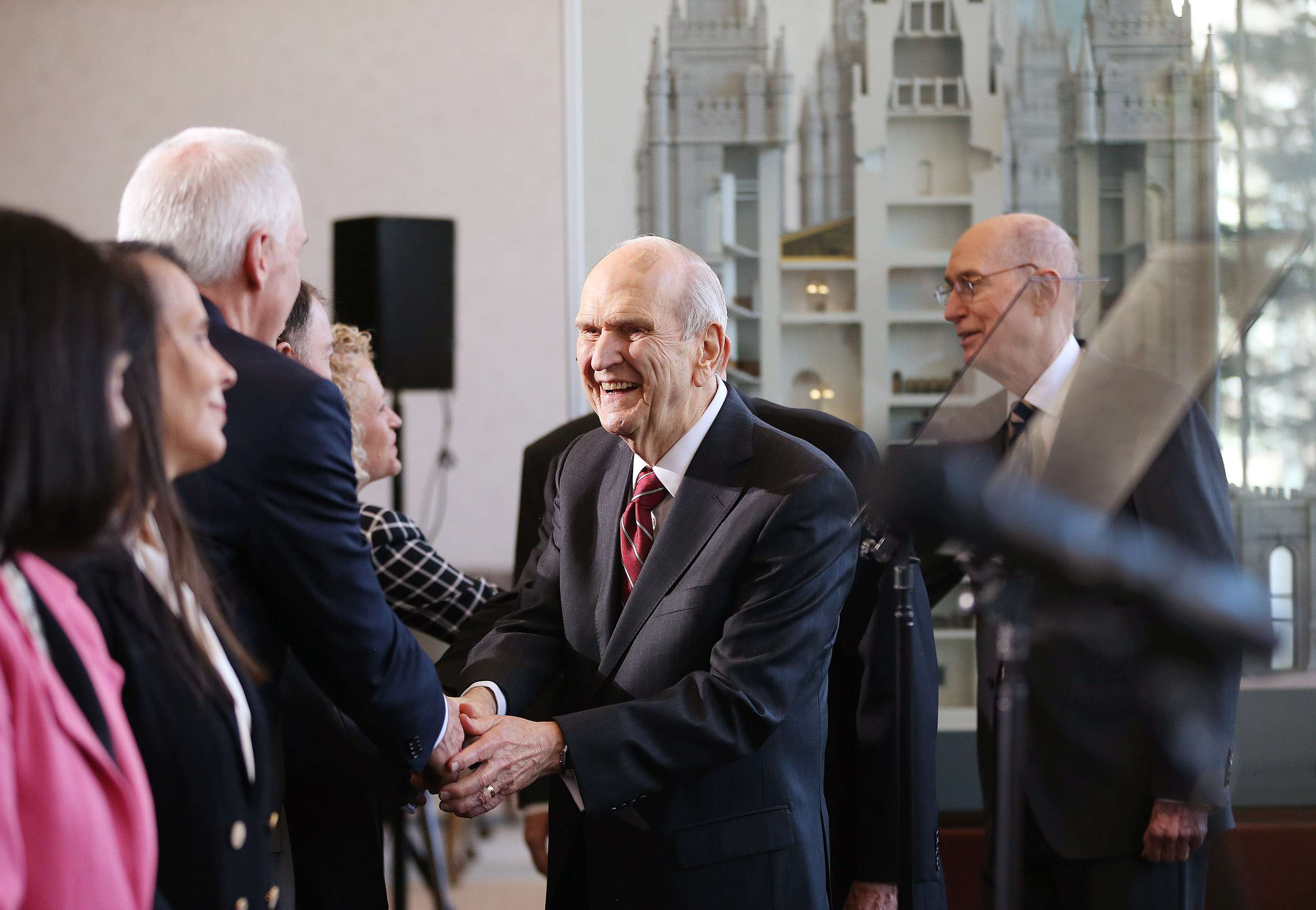 President Russell M. Nelson of The Church of Jesus Christ of Latter-day Saints shakes hands with dignitaries prior to speaking during a press conference in Salt Lake City on Friday, April 19, 2019 about renovations to the Salt Lake Temple and grounds.