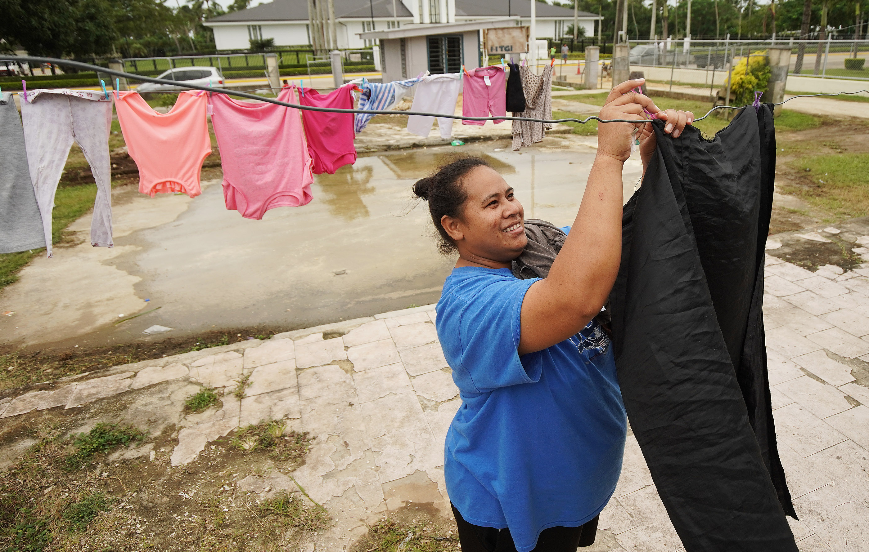 A woman hangs laundry in Tonga on May 23, 2019.