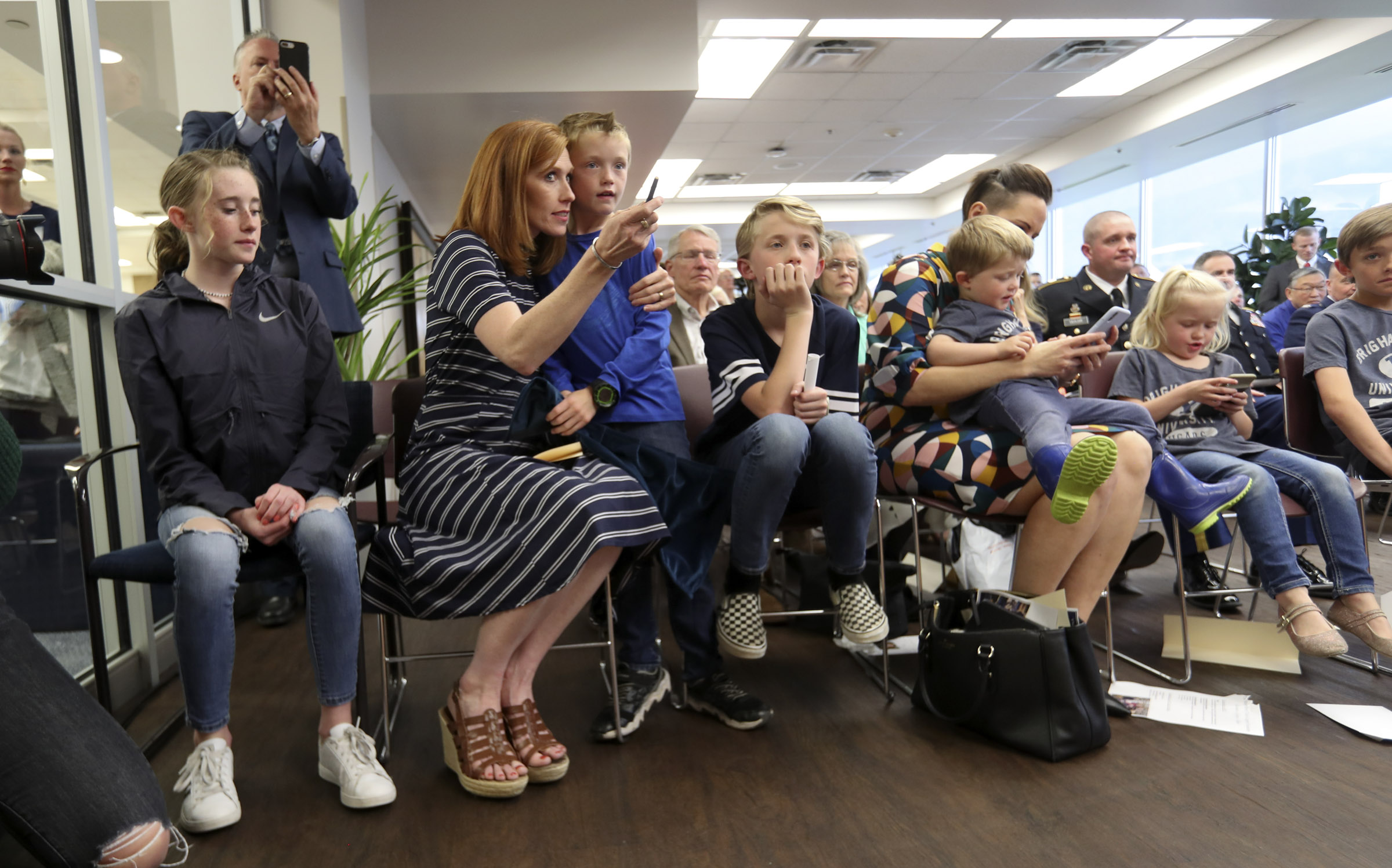 Jennie Taylor sits with her children during a ceremony where the name of her husband, Maj. Brent Taylor, was added to the Reflection Room Memorial Wall in the Wilkinson Center on the BYU campus in Provo on Thursday, May 23, 2019. Taylor was killed in Afghanistan in 2018.