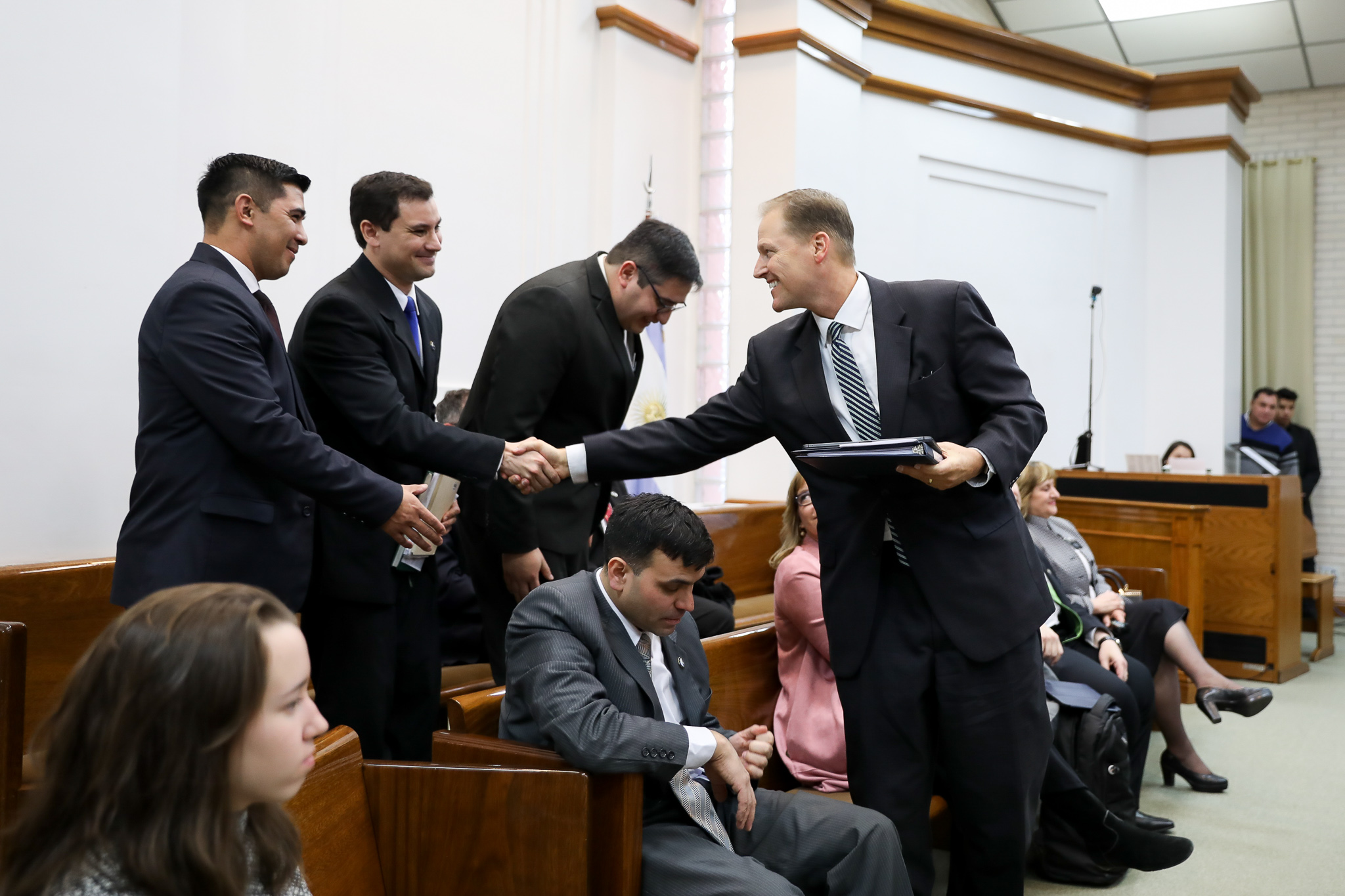 Elder Mark A. Bragg shakes hands with members of the new Tierra del Fuego Argentina Stake on June 2, 2019.