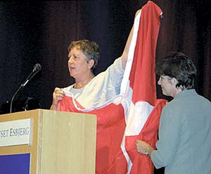 Tove Bisgaard presents flag of Denmark to DeAnn J. Sadleir, co-chairman of Sea Trek.