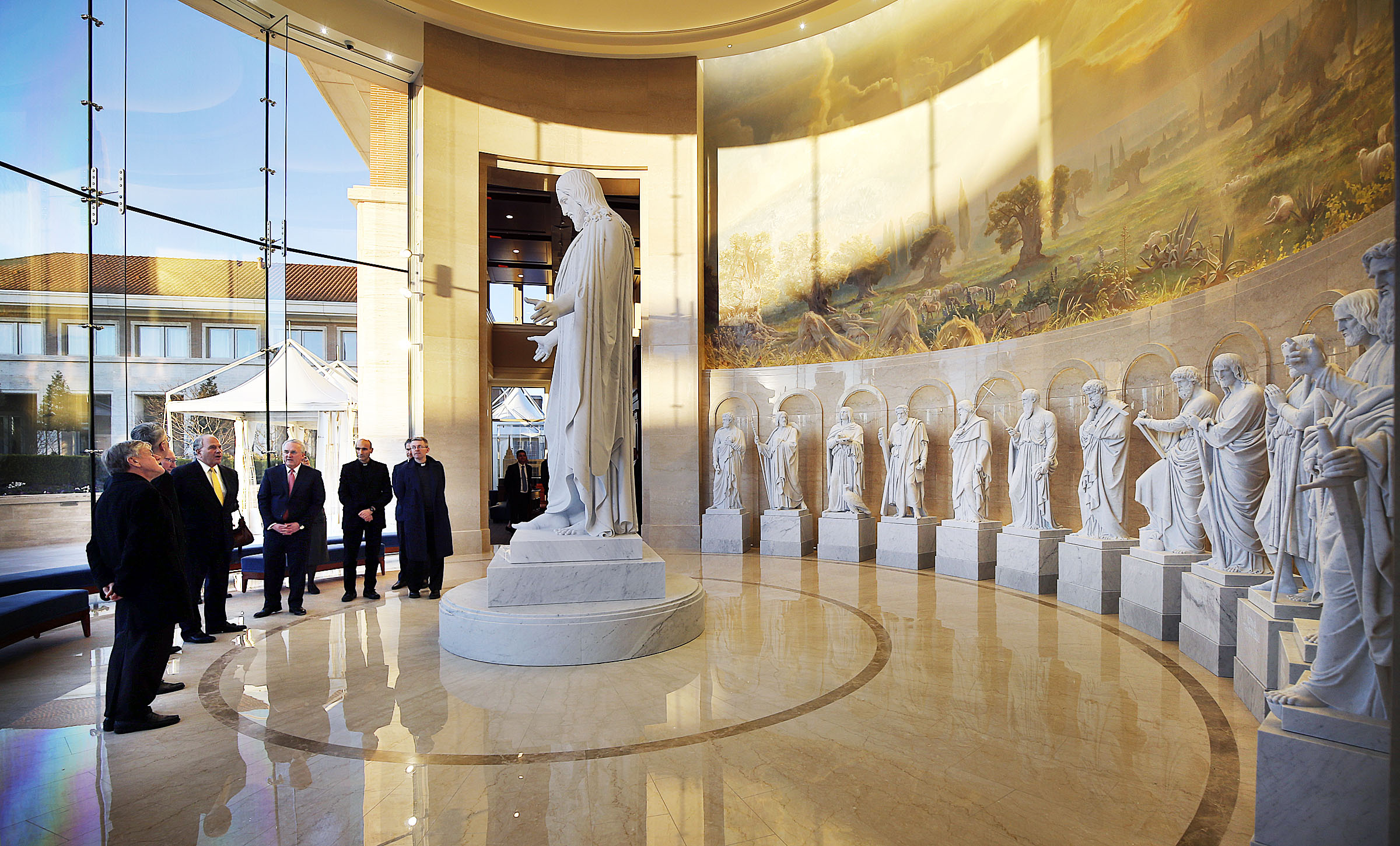 Elder Ronald A. Rasband and Elder Jack N. Gerard of The Church of Jesus Christ of Latter-day Saints lead a group from the Pontifical Council for Promoting Christian Unity during a tour of the Rome Italy Temple and grounds on Tuesday, Jan. 15, 2019.