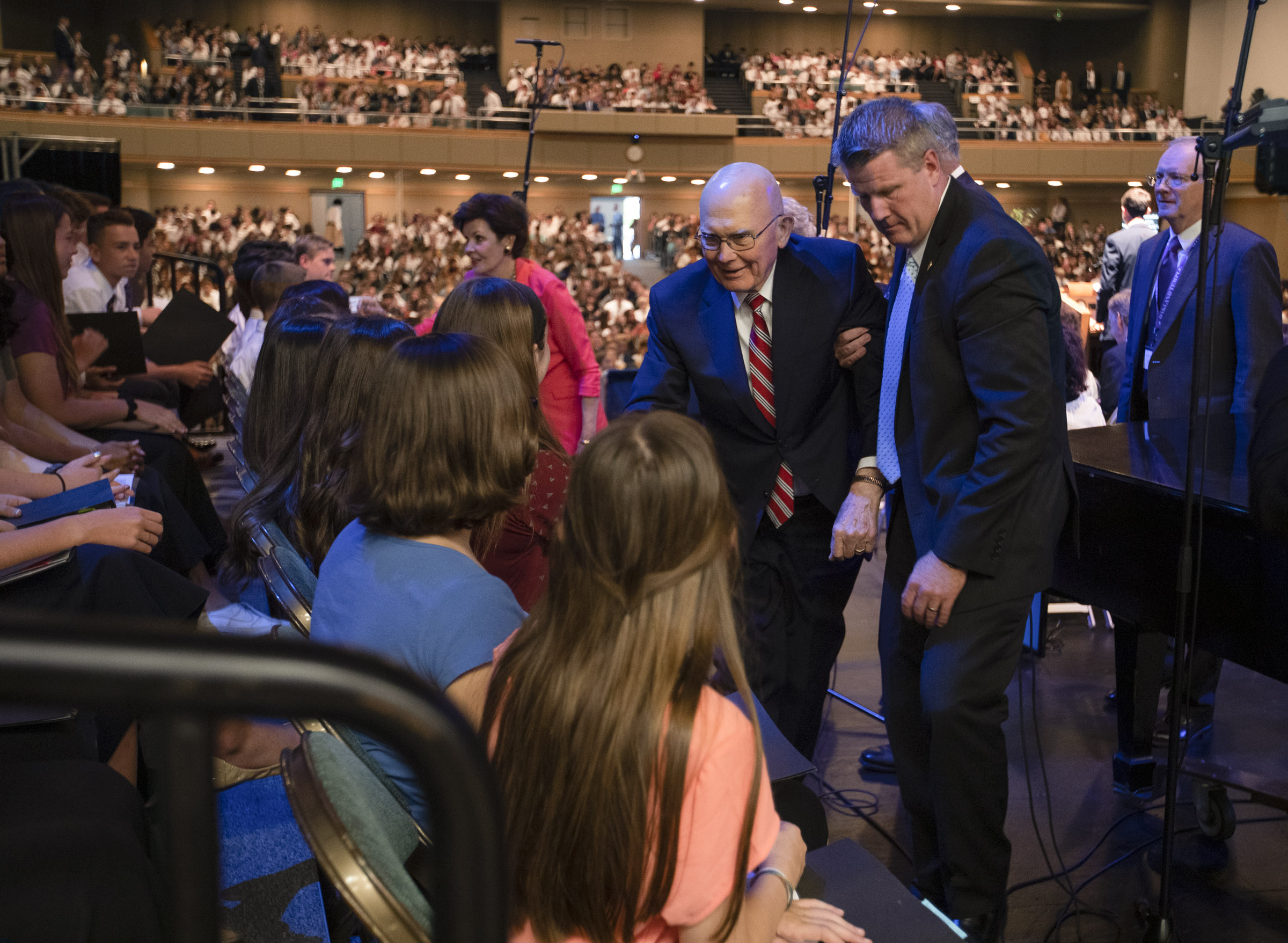 President Dallin H. Oaks, first counselor in the First Presidency of The Church of Jesus Christ of Latter-day Saints, shakes hands with youth attending a devotional at the Interstake Center on the Oakland California Temple grounds on Saturday, June 15, 2019.