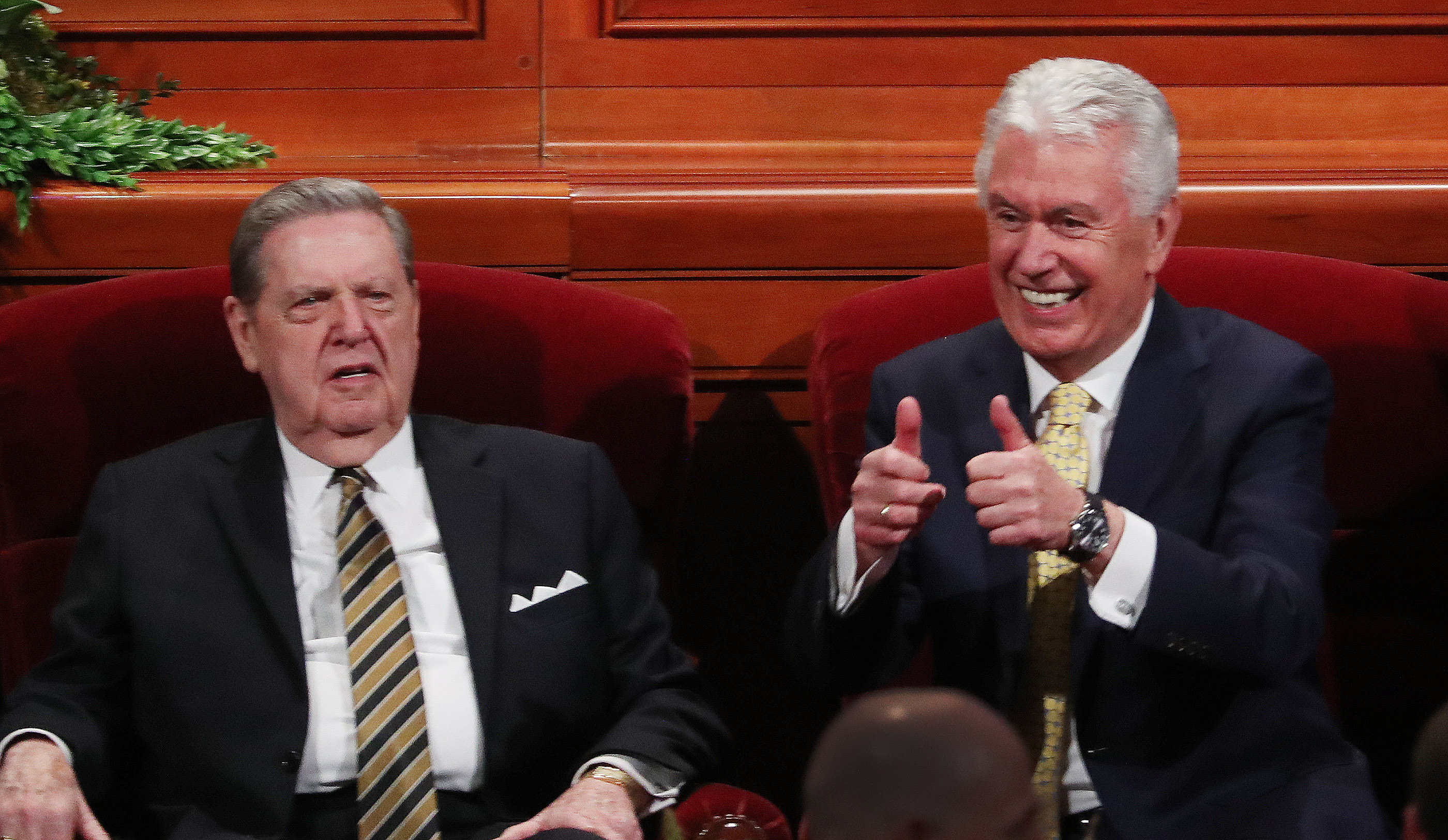 Elder Jeffrey R. Holland and Elder Dieter F. Uchtdorf react to attendees prior to the 189th Annual General Conference of The Church of Jesus Christ of Latter-day Saints in Salt Lake City on Saturday, April 6, 2019.
