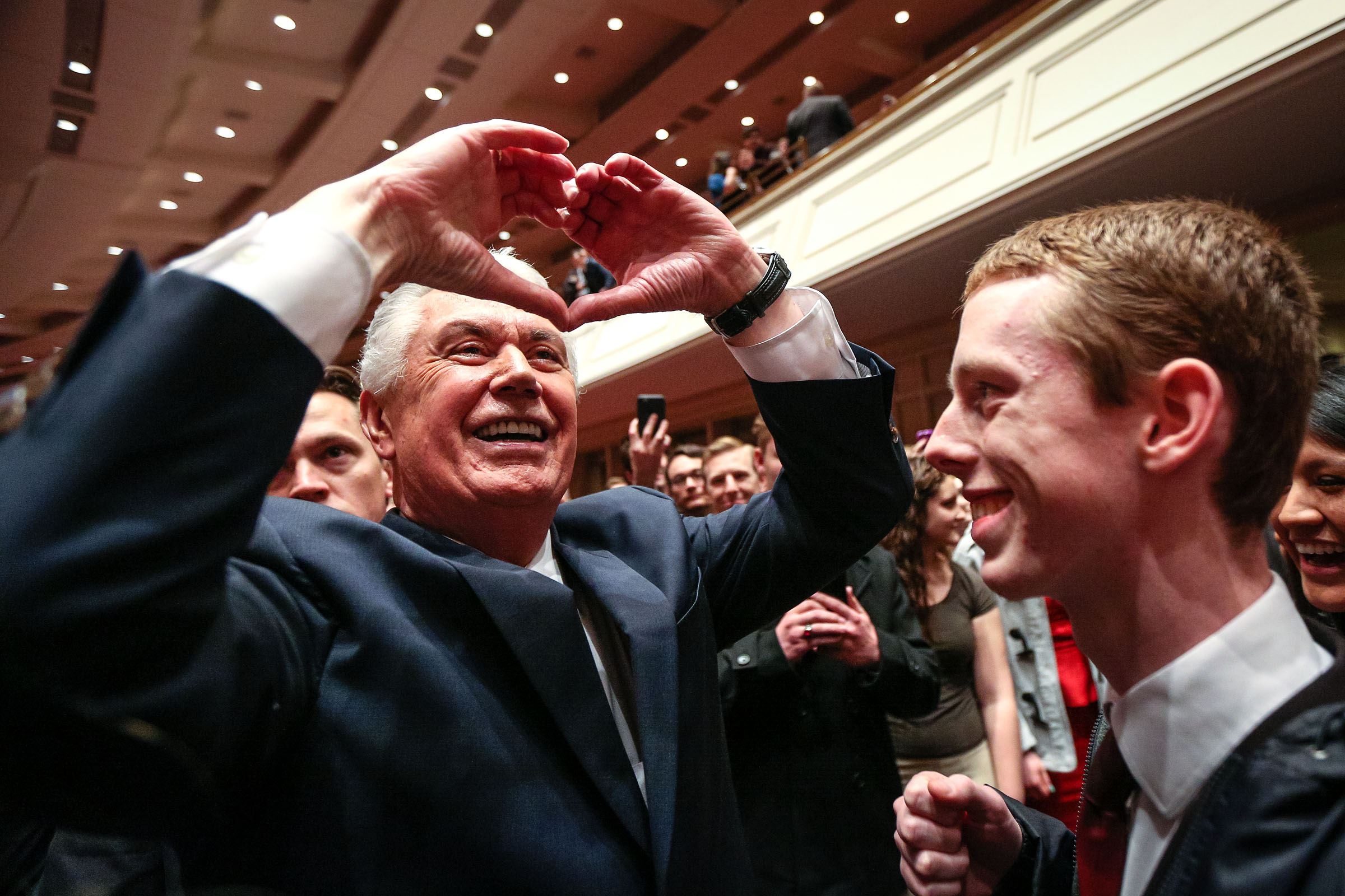 Elder Dieter F. Uchtdorf makes a heart shape with his hands to the devotional goers as he exits through the main seating area after the World Wide Devotional for Young Adults hosted by Elder Dieter F. Uchtdorf at the Conference Center in Salt Lake Sunday, Jan. 14, 2018.