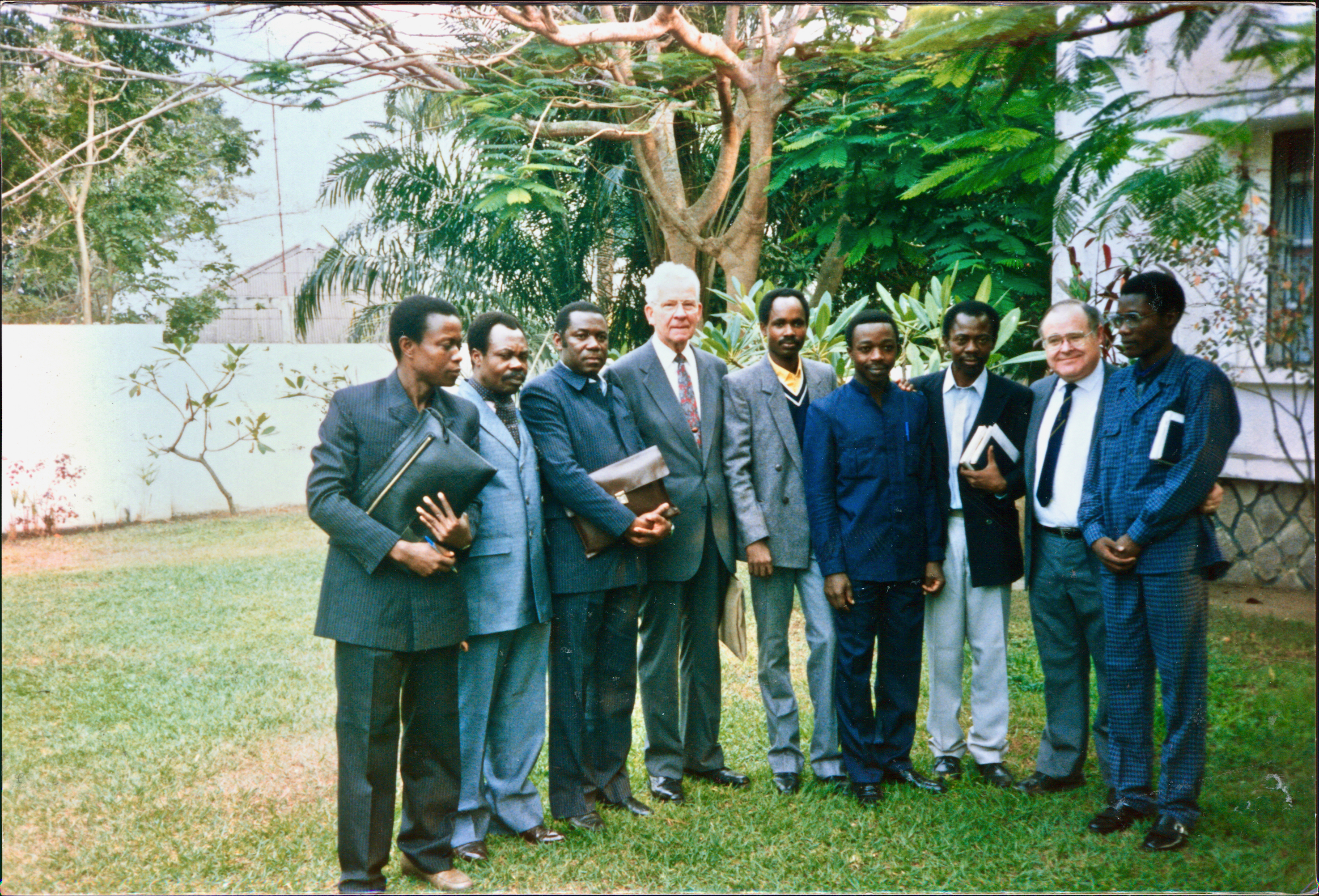 Elder Marvin J. Ashton of the Quorum of the Twelve Apostles, fourth from right, and Elder Alexander B. Morrison of the Seventy, second from right, are joined by members of the Kinshasa Branch presidency and elders quorum presidency on Aug. 30, 1987, the day that Elder Ashton dedicated the country — then known as Zaire, now known as the Democratic Republic of the Congo — for the preaching of the gospel. Joining them are, from left, Brothers Makela, Shambuyi Biaya, Mawangi, Lendo, Nkitabungi, Bofanga and Ethenji.