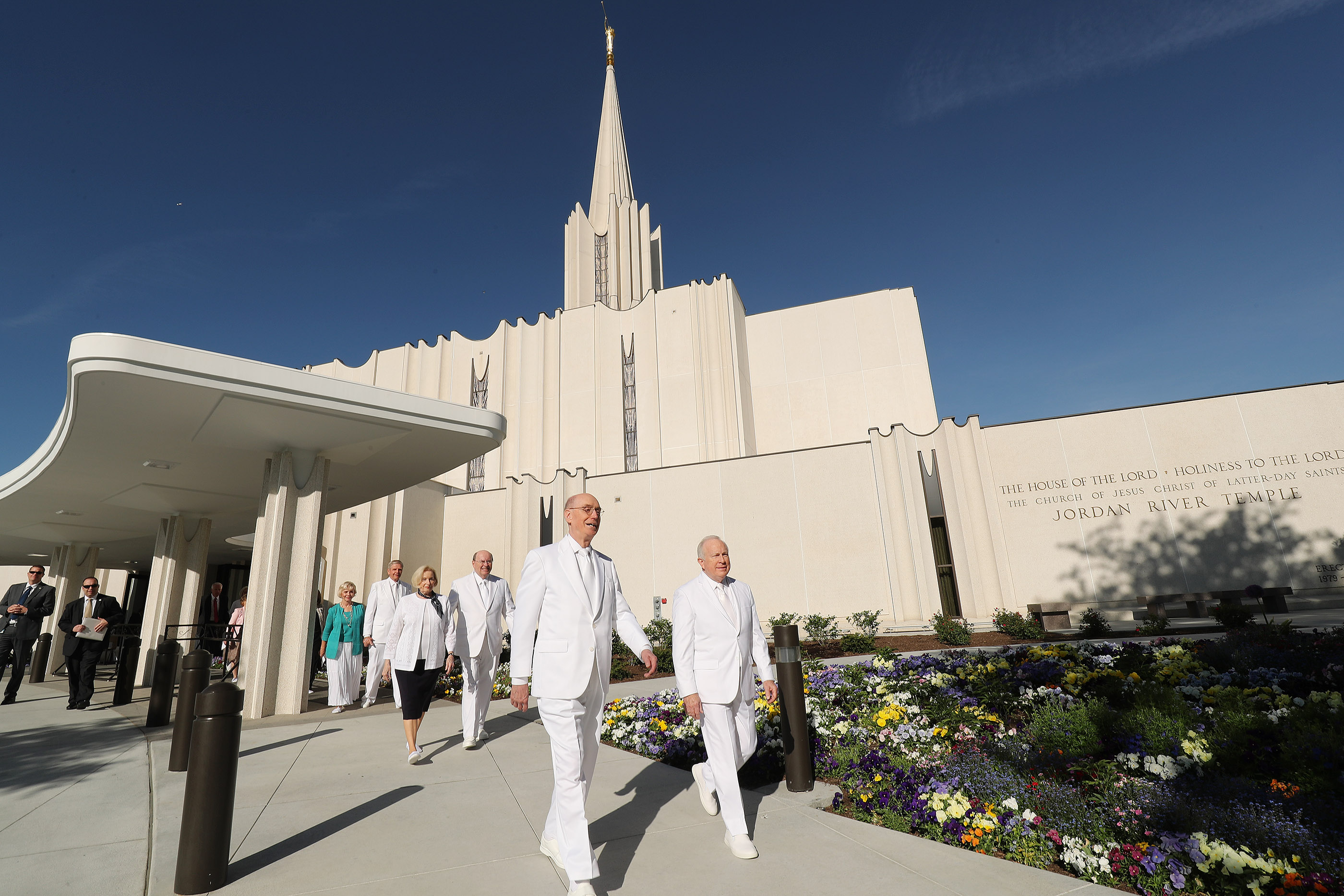President Henry B. Eyring, second counselor in the First Presidency, left, and Elder Timothy J. Dyches, General Authority Seventy, right, walk outside the Jordan River Utah Temple prior to rededication services in South Jordan on Sunday, May 20, 2018.