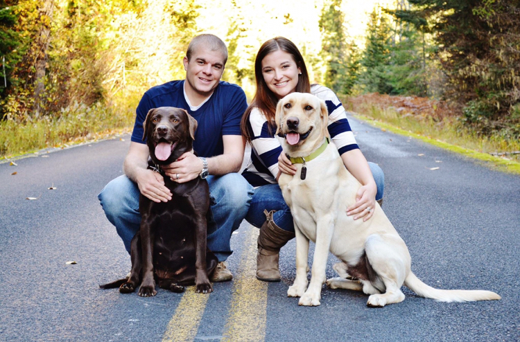 A.J and Sarah Edwards with their dogs Lily and Pad. The Edwards are expecting their first child — a baby girl.