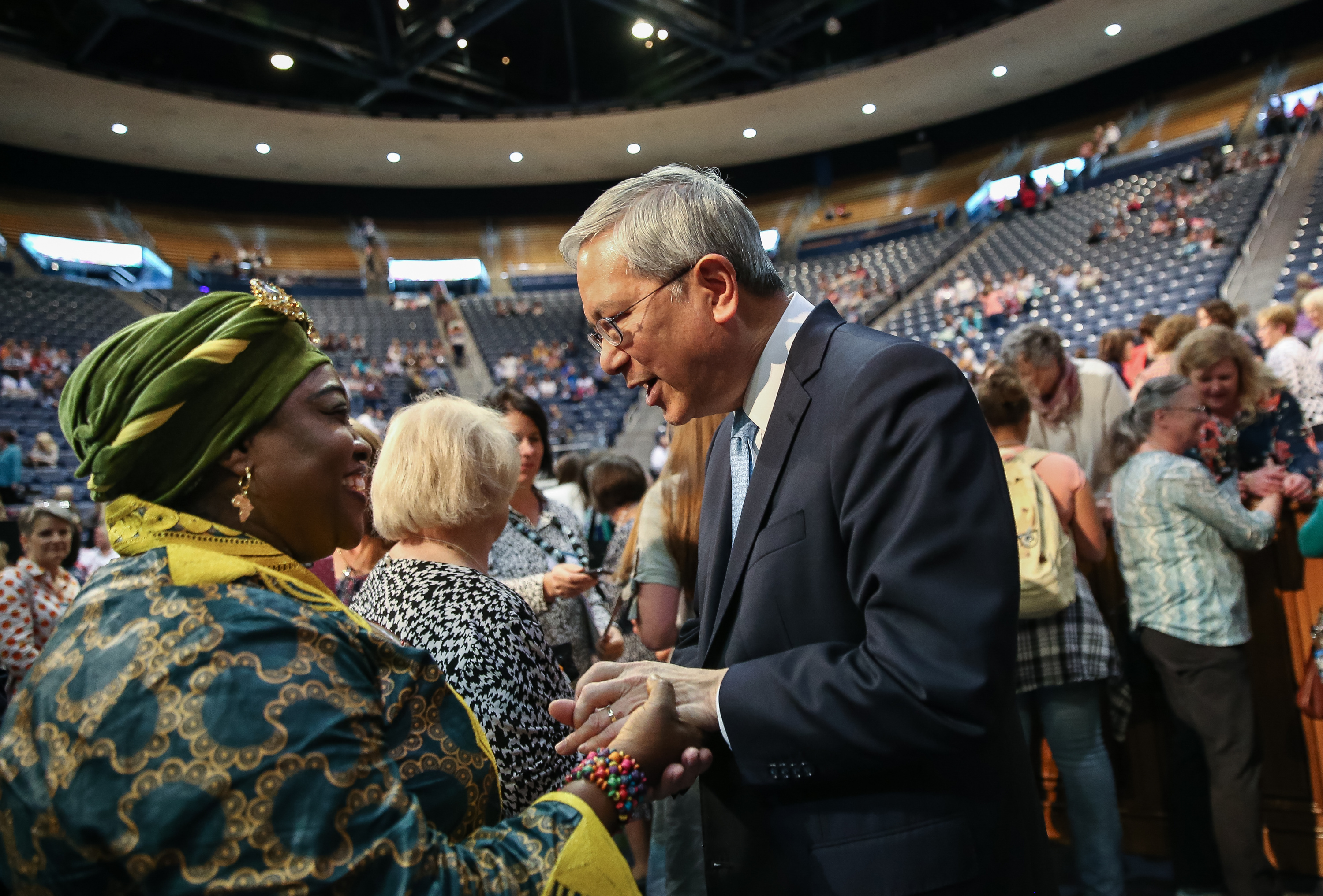 Elder Gerrit W. Gong, of the Quorum of the Twelve Apostles of the LDS Church, greets Mariama Olayemi, of Sierra Leone and now living in Salt Lake City, after Gong spoke at the BYU Women's Conference at the Marriott Center in Provo on Friday, May 4, 2018.
