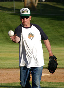 Ralph Olson throws a pitch during a Church softball game in Bountiful, Utah, on Thursday, July 8, less than two months short of his 80th birthday.