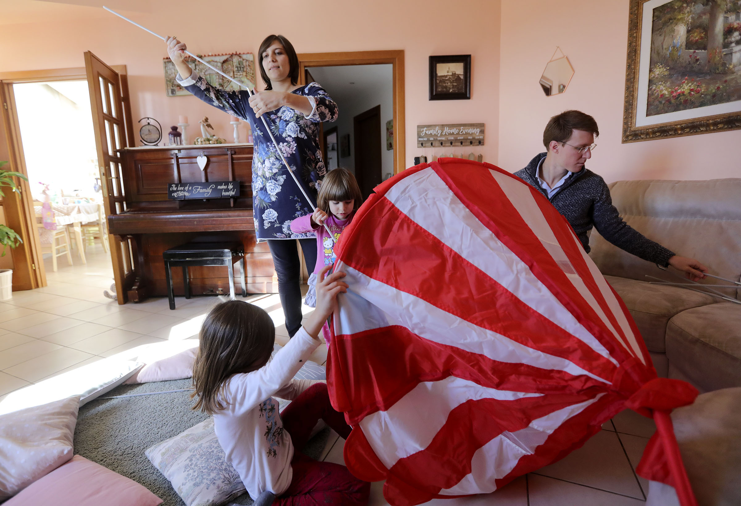 Emma and Alice Salerno put a tent together with their parents, Norma and Daniele, at home in Rome, Italy, on Sunday morning, Nov. 18, 2018.