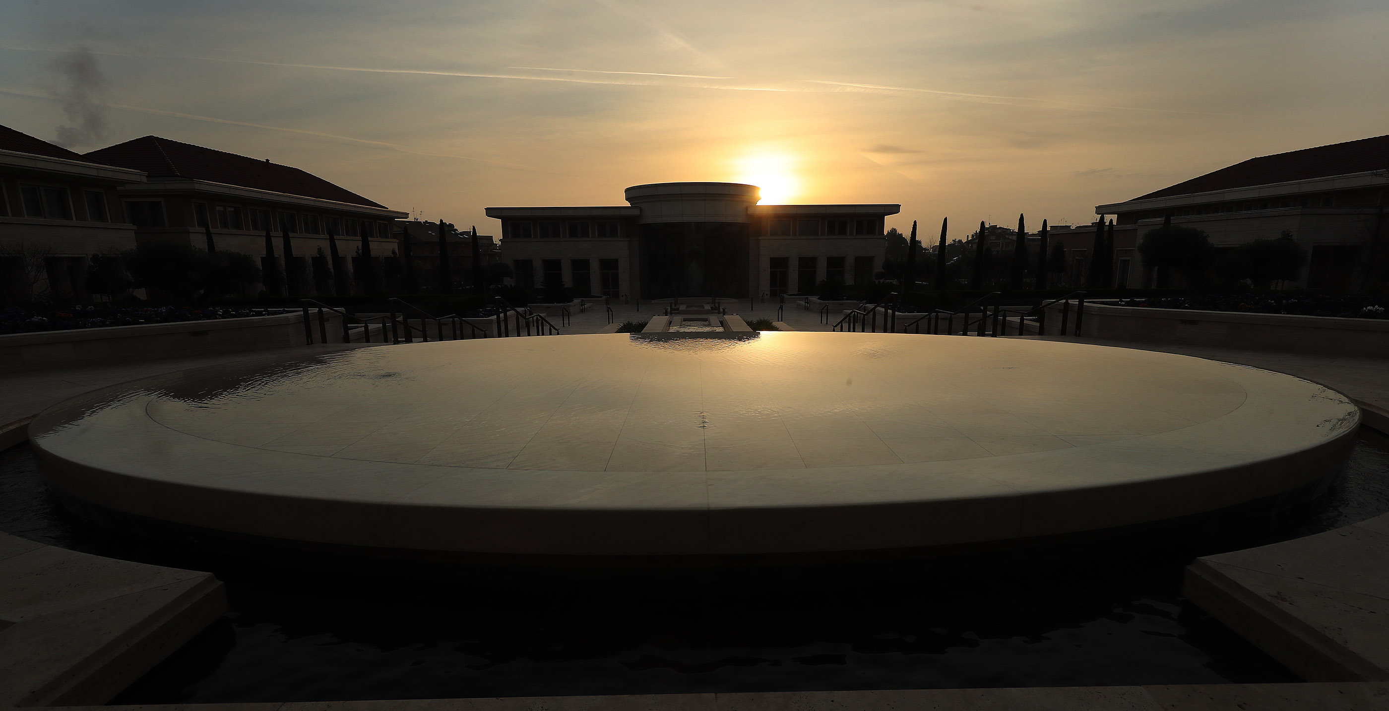 The water pond reflects the morning light near the Rome Italy Temple Visitors' Center of The Church of Jesus Christ of Latter-day Saints in Rome, Italy, on Friday, March 8, 2019.