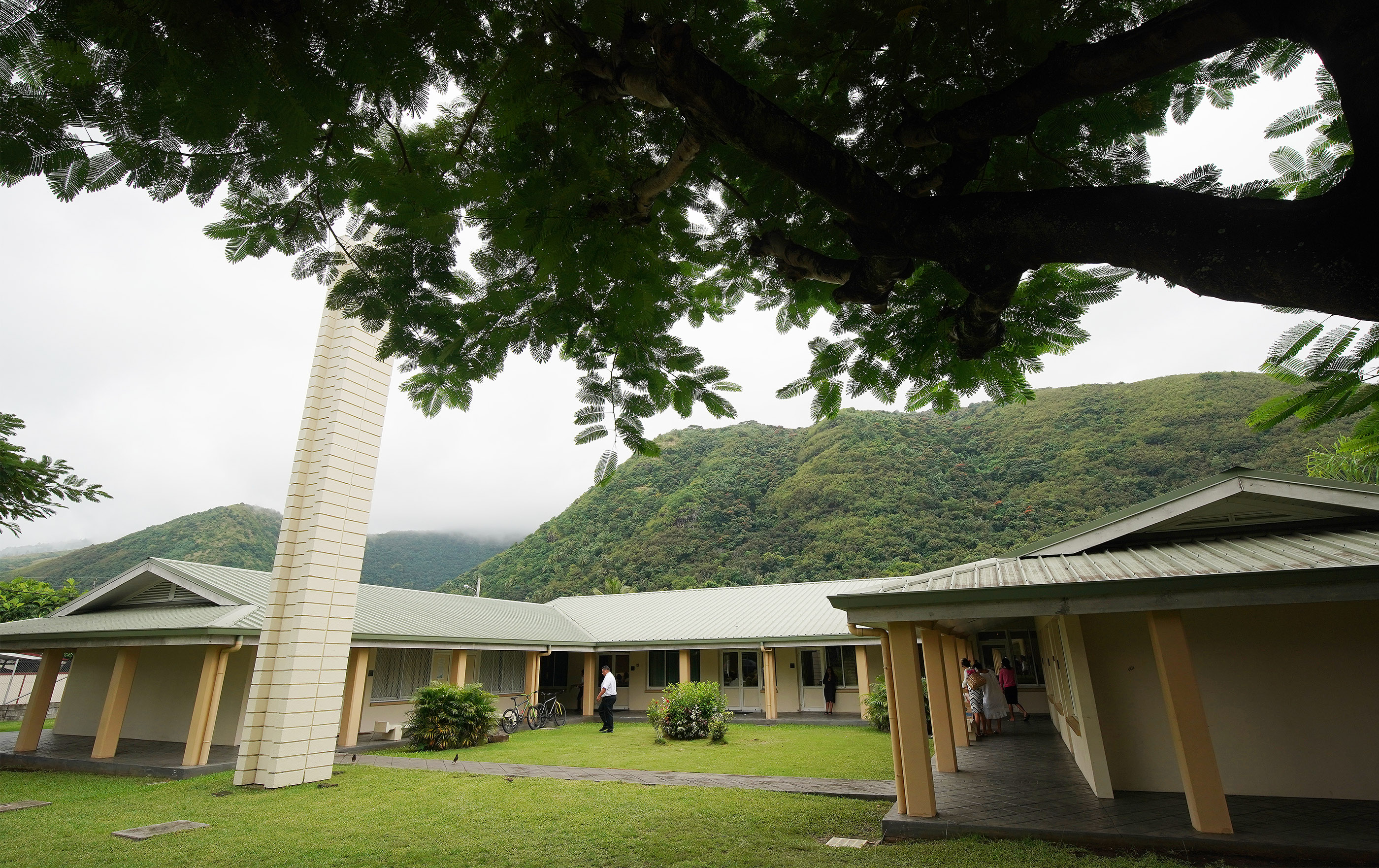 Members walk between meetings at The Church of Jesus Christ of Latter-day Saints in Papeete, Tahiti, on May 26, 2019.