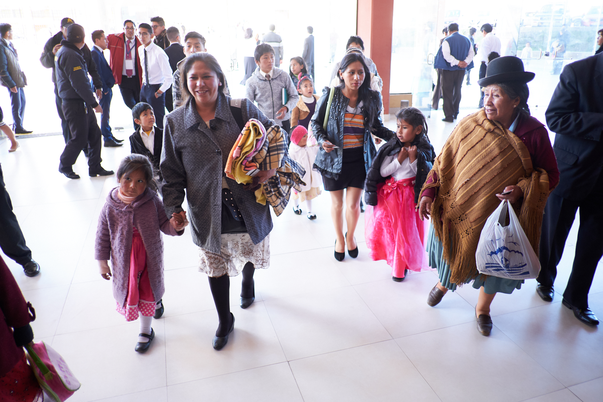 Bolivian families arrive at the Polideportivo Heroes de October in El Alto, Bolivia, for the chance to hear President Russell M. Nelson in an evening devotional Sunday, Oct. 21, 2018.