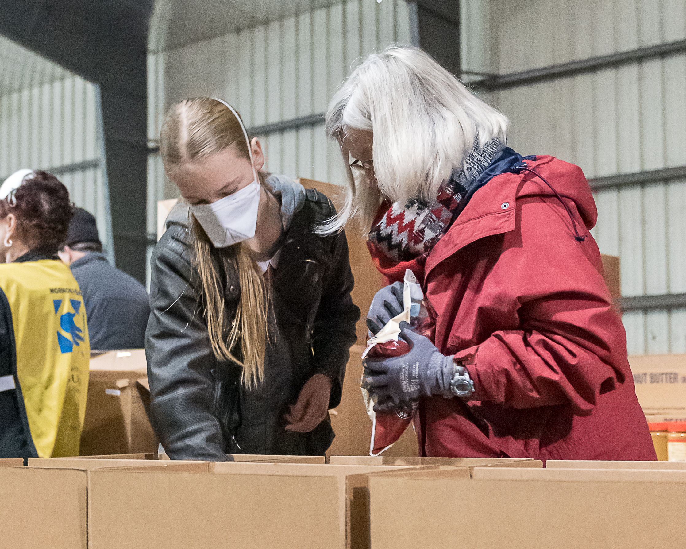 Volunteers load goods and supplies in Oroville, California, on Nov. 17, 2018, to give to those impacted by California's deadliest wildfire, which heavily damaged Paradise, California.