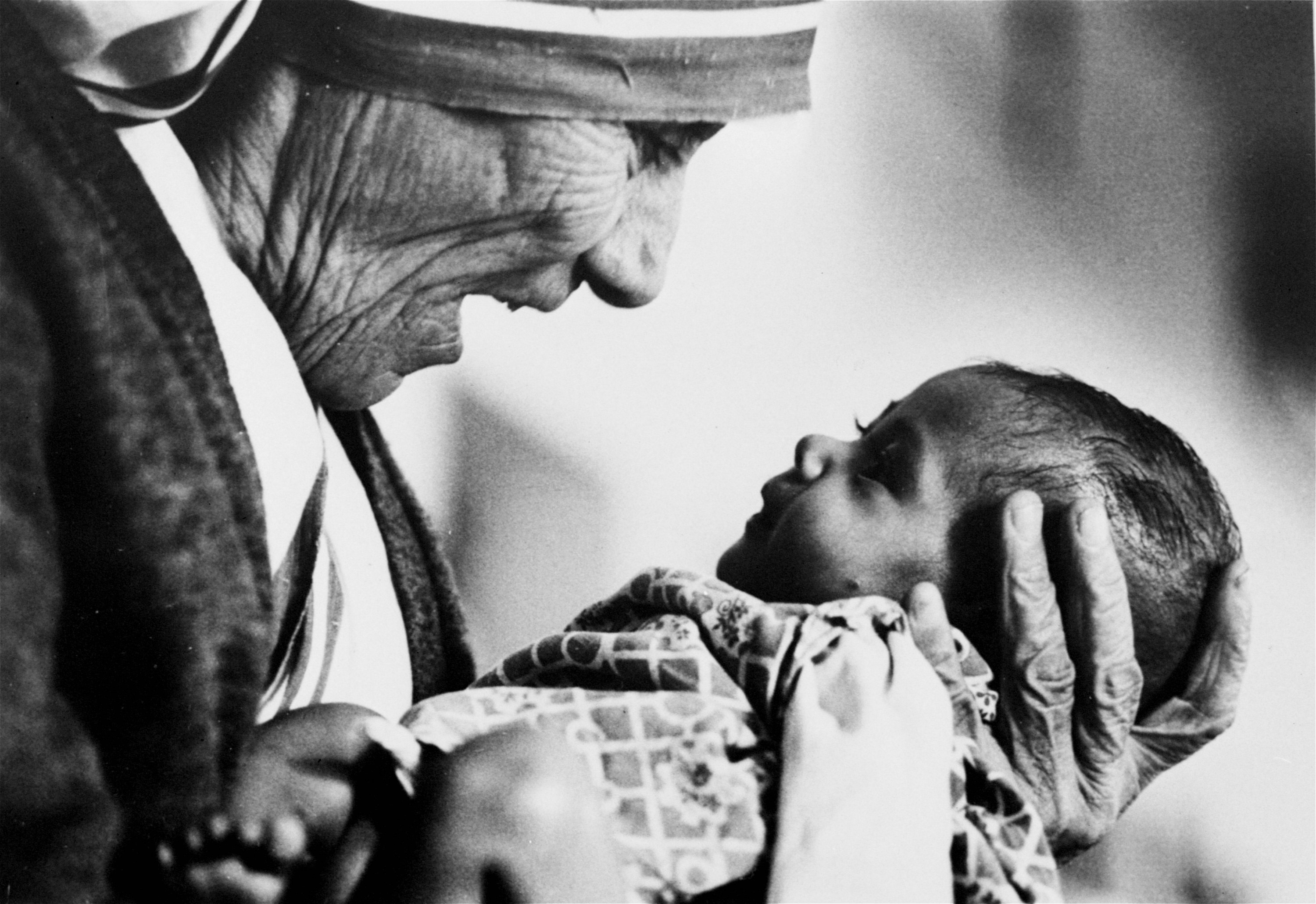 Mother Teresa, head of the Missionaries of Charity order, cradles an armless baby girl at her order's orphanage in what was then known as Calcutta, India, in 1978.
