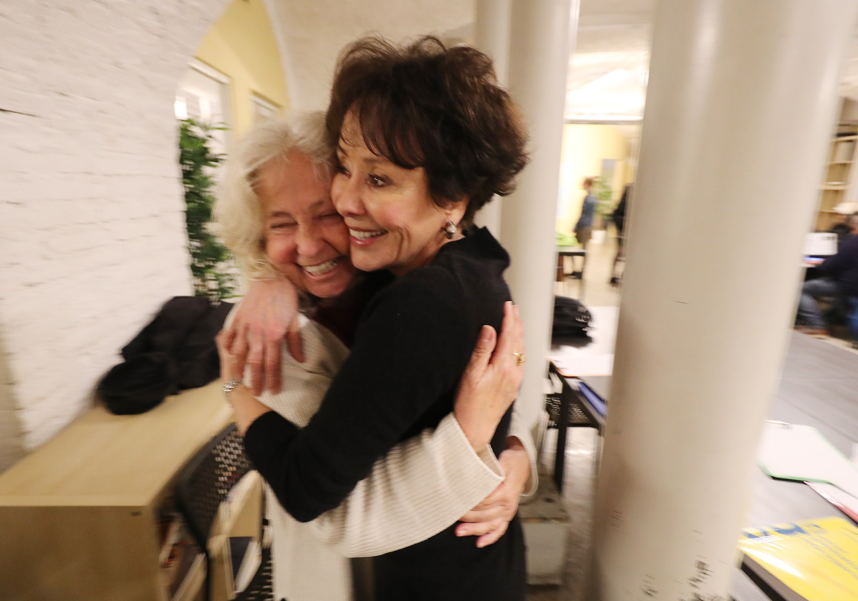 Latter-day Saint Charities missionary Sister Anita Canfield, right, hugs Latter-day Saint volunteer Cecilia Panecianco at the Latter-day Saint Charities Friendship Center in Rome, Italy.