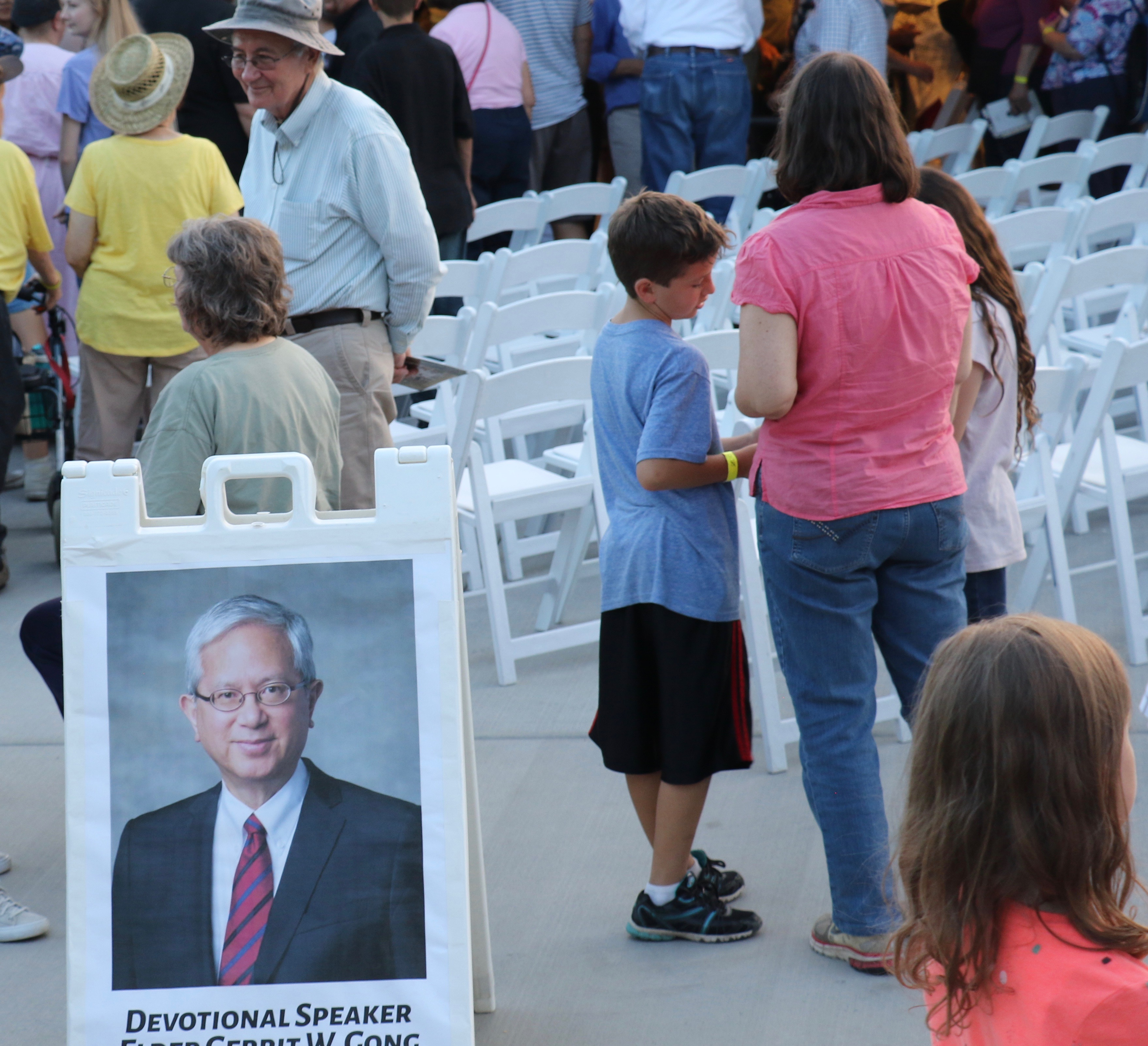 People gather on July 16, 2018, at pavilion at Utah's This Is the Place Heritage Park prior to devotional message from Elder Gerrit W. Gong.