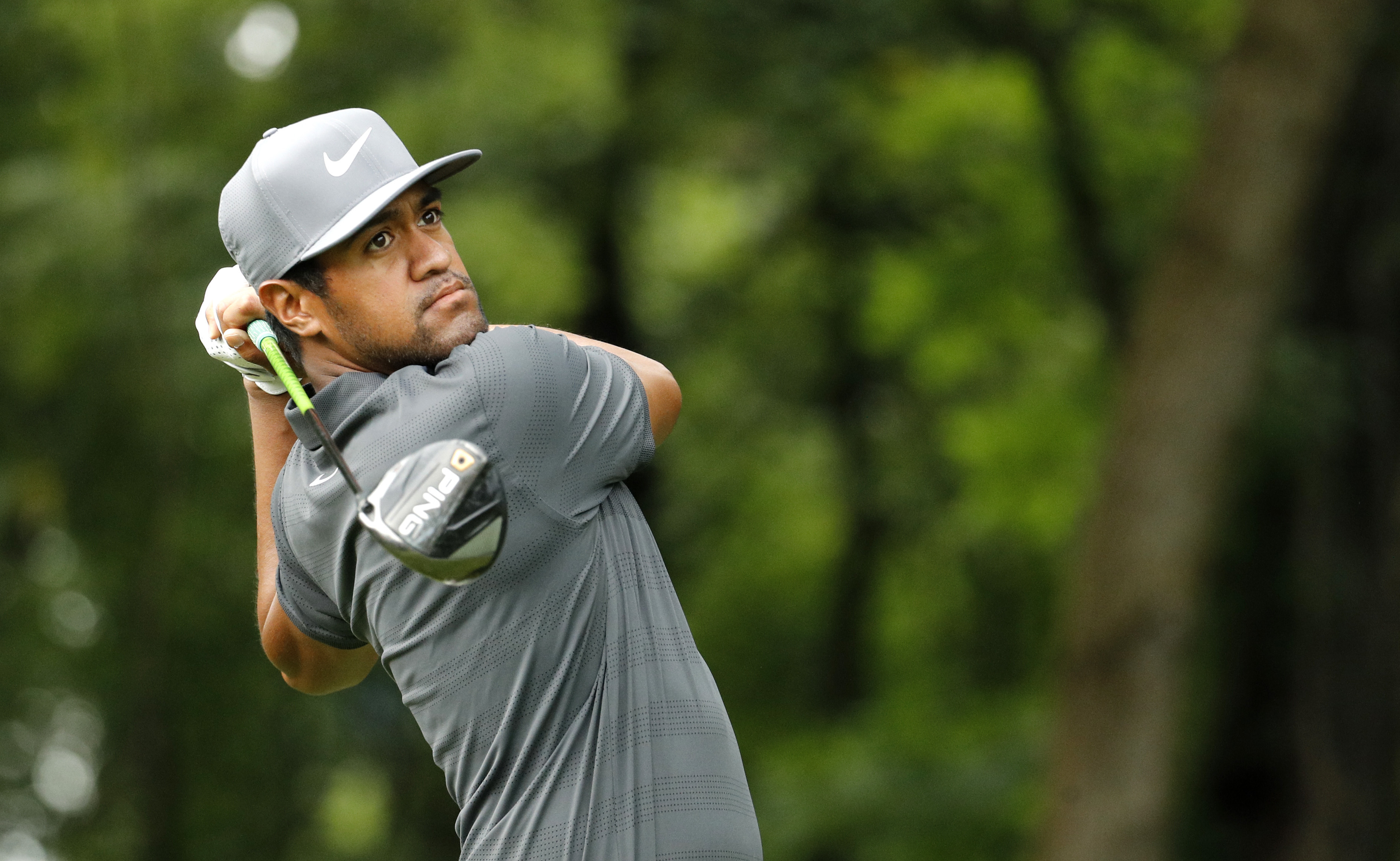 In this Tuesday, Aug. 7, 2018 file photo, Tony Finau hits on the 17th tee during a practice round for the PGA Championship golf tournament at Bellerive Country Club in St. Louis.