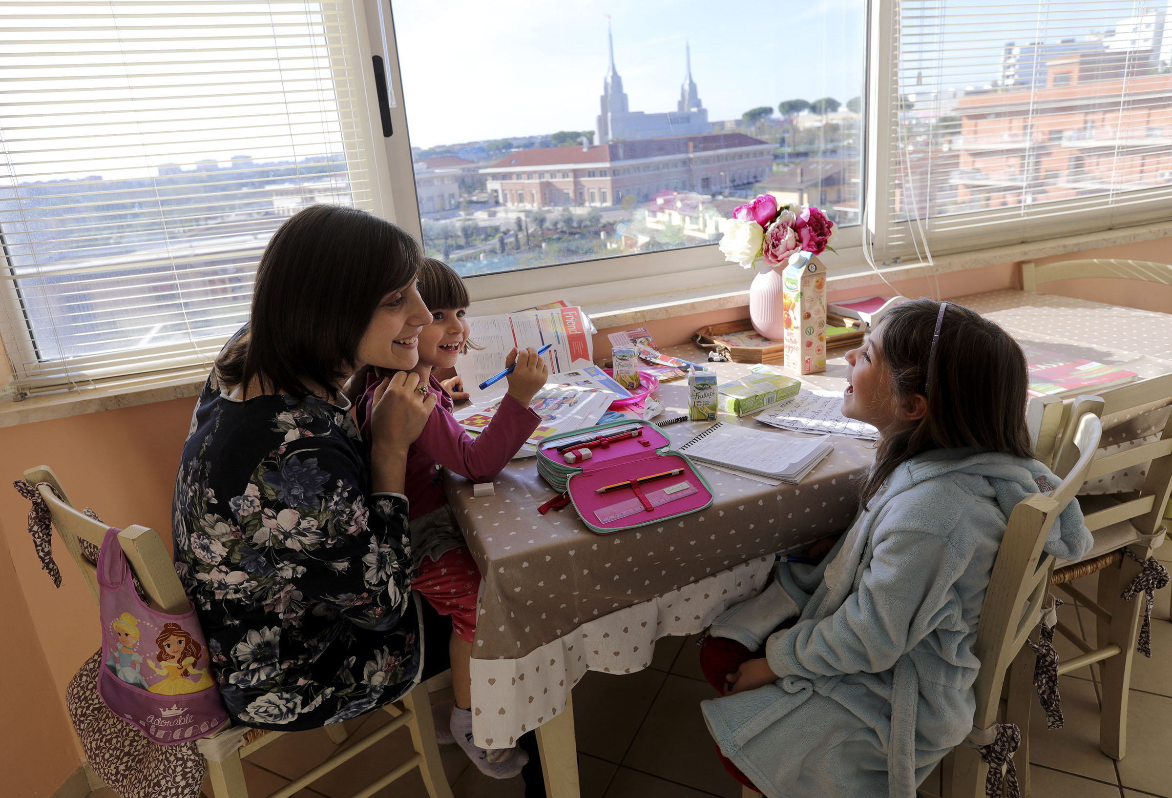 Norma Salerno chats with her daughters, Alice and Emma, at the kitchen table, with an overlooking view of the the Rome Italy Temple, at their Rome apartment on Sunday morning, Nov. 18, 2018.