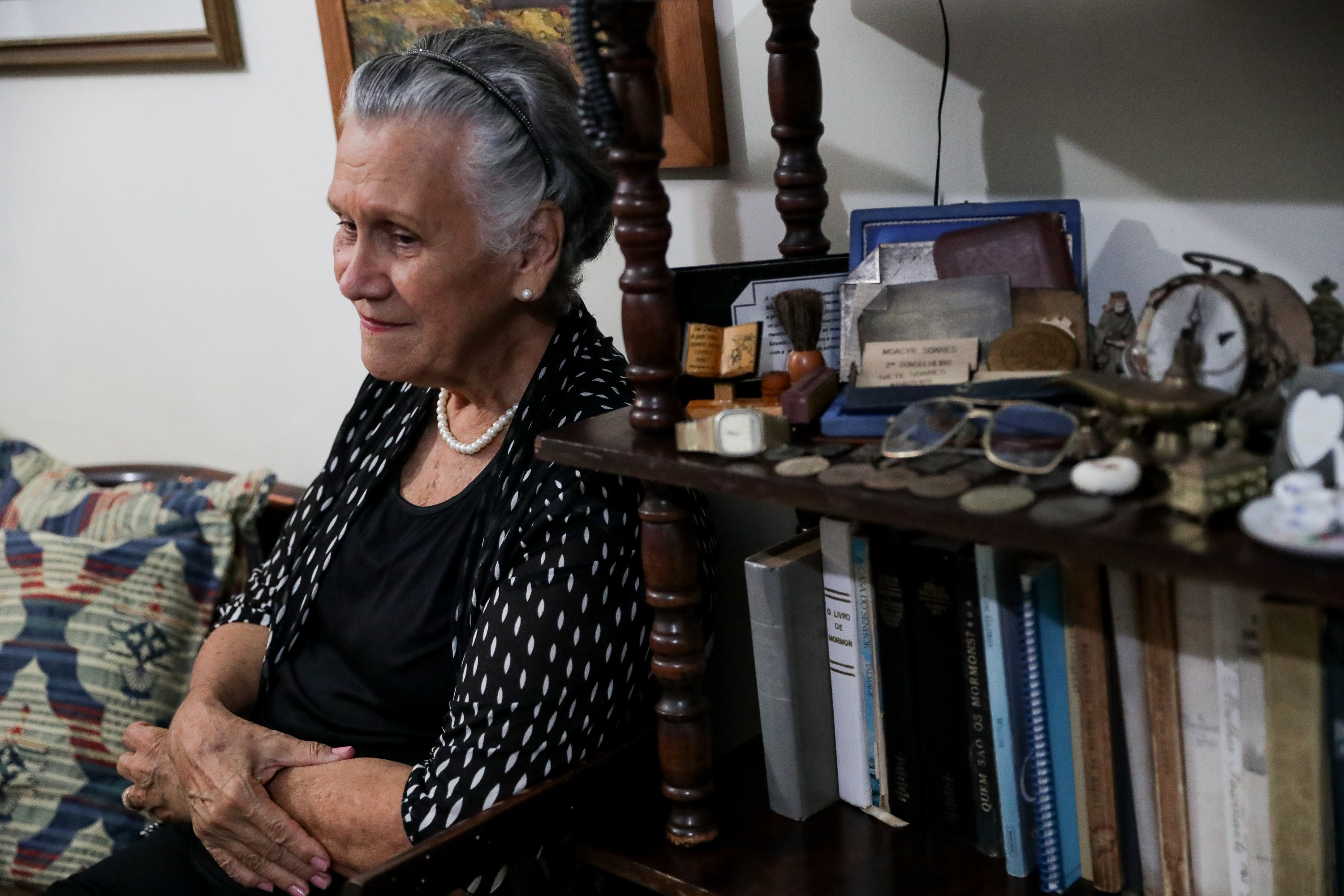Ivete Sodré Da Motta Soares recalls taking long bus journeys to visit the Sao Paulo temple in her apartment in Recife, Brazil, on Saturday, May 26, 2018.