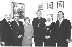 At a ceremony sponsored by the Church in Perth, Australia, from left, Elder Kenneth Johnson of the Seventy presented Family Values Awards to community members Colin and Cheryl Edwards, Archbishop Barry Hickey, and Mona and Hamza Amira.