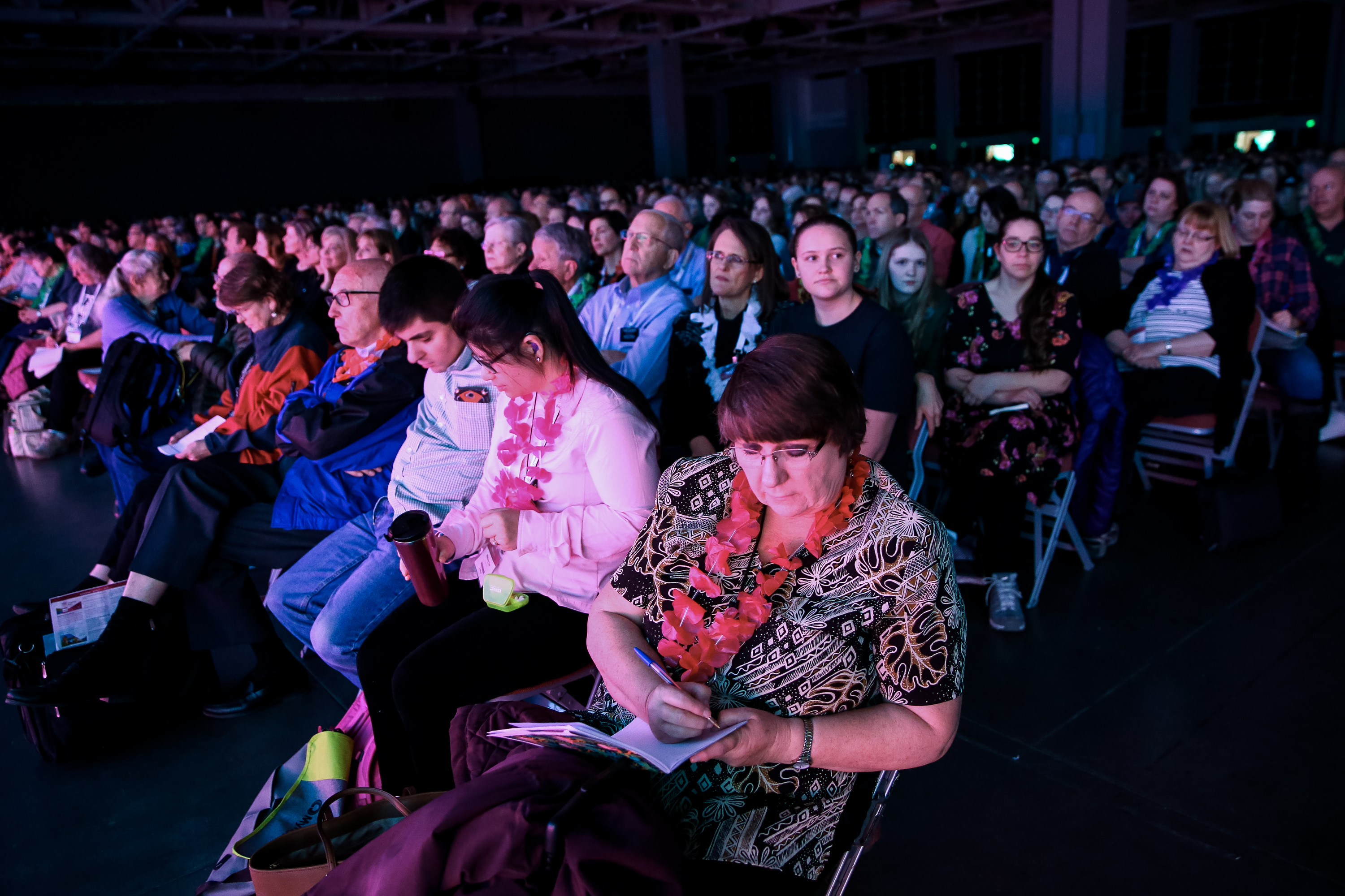 Shari Kone takes notes as Elder David A. Bednar of the Quorum of the Twelve Apostles and his wife, Sister Susan Bednar, speak during the RootsTech conference, held at the Salt Palace in Salt Lake City on Saturday, March 2, 2019.