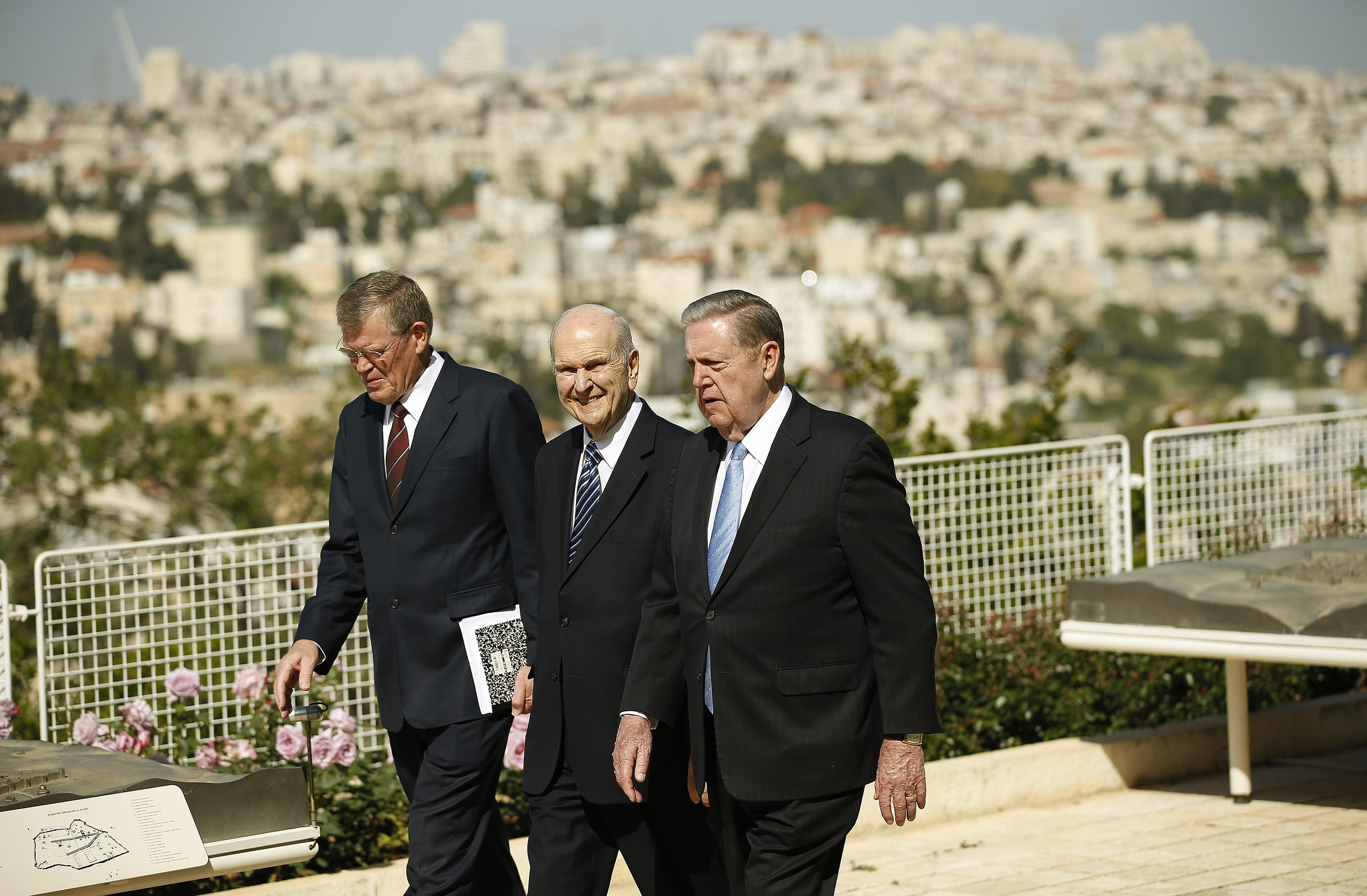President Russell M. Nelson, president of The Church of Jesus Christ of Latter-day Saints, center, Elder Jeffrey R. Holland, of the Quorum of the Twelve Apostles, right, and District President Dennis Brimhall walk at the BYU Jerusalem Center in Jerusalem on Saturday, April 14, 2018. President Nelson is on a global tour of eight countries.