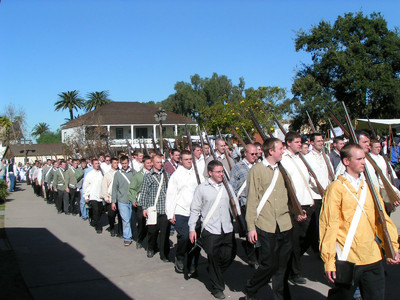 Full-time missionaries and other Church members parade during a reenactment of the Mormon Battalion's march into San Diego during events commemorating the battalions original arrival there in 1847.