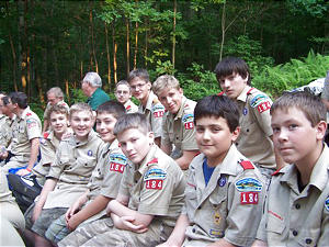 Memebers of Scout Troop 184 wait for an evening fireside at Camp Tuckahoe, Dillsburg, Pa., at a regional Scout encampment.